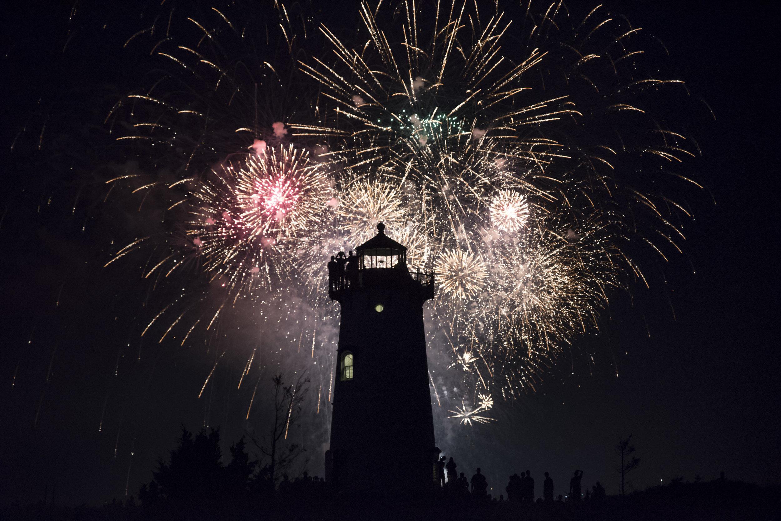 Fireworks explode behind the Edgartown Light House in Edgartown, Massachusetts.
