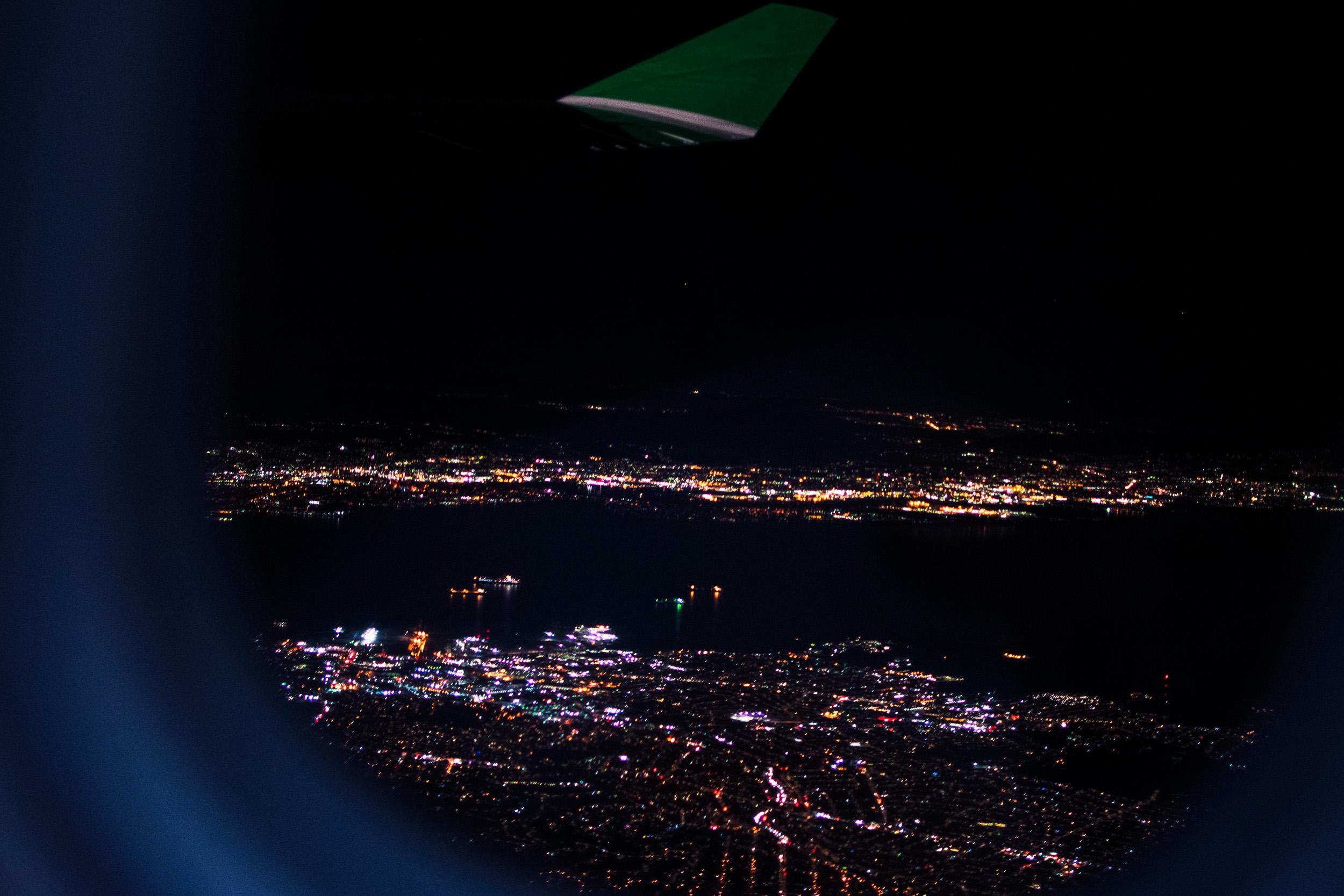 airplane window night time city stock.jpg