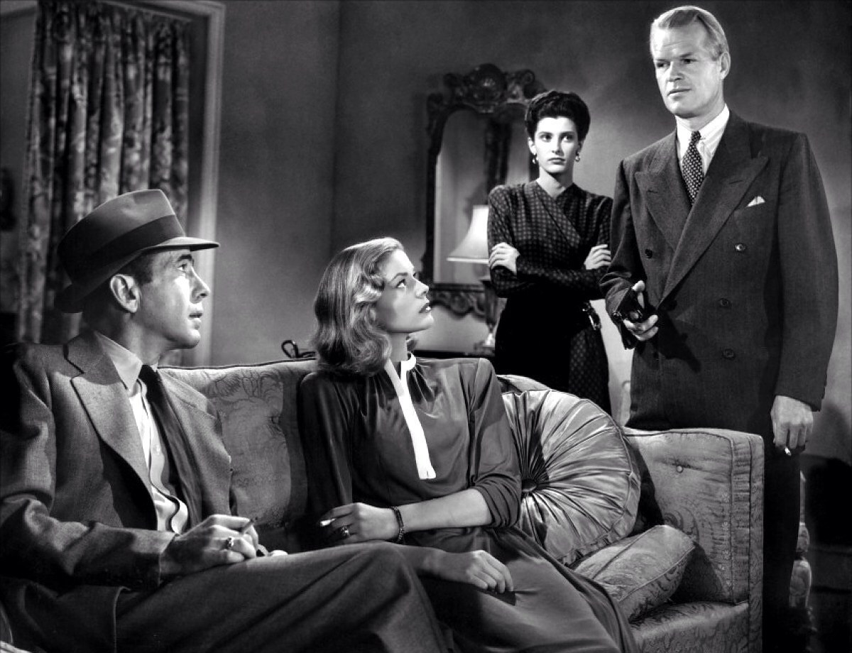 """She tried to sit on my lap while I was standing up,"" Philip Marlowe. A quote from The Big Sleep. Foto credit: Warner Home Video"