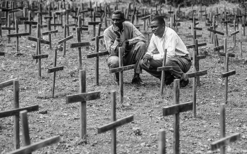 Tutsi pastor Anastase Sabamungu (left) and Hutu teacher Joseph Nyamutera visit a Rwandan cementary where 6,000 genocide victims are buried. Photo credit: John Warren/ World Vision, 2008). Retrieved from:  https://www.worldvision.org/refugees-news-stories/1994-rwanda-genocide-facts