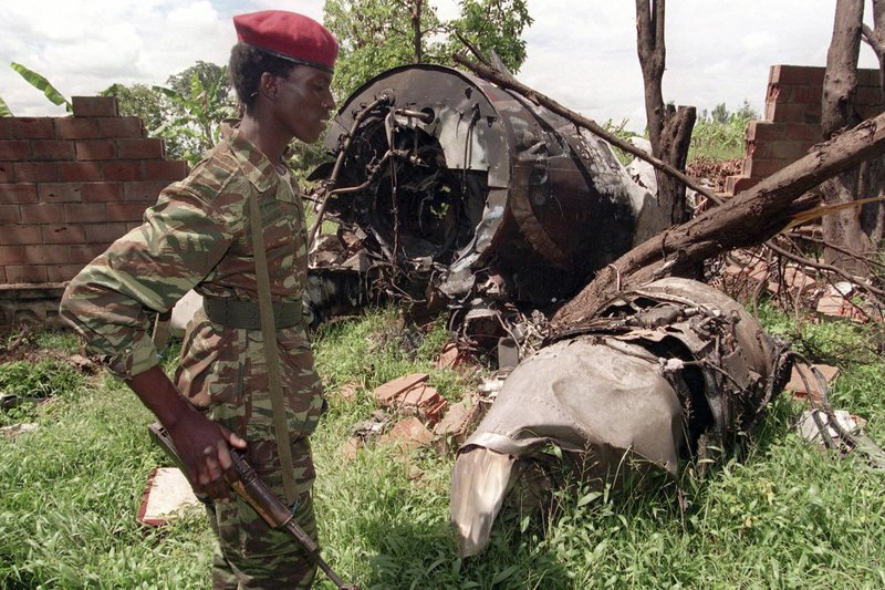 A Rwanda Patriotic Front (RPF) rebel walks by the the site of a April 6 plane crash which killed Rwanda's President Juvenal Habyarimana in this May 23, 1994 file photo in Kigali. Photo credit: AP Photo/Jean Marc Bouju. Retrieved from:  https://www.apnews.com/f3c9582e4deb4d21b69ca9f80c6f25d5