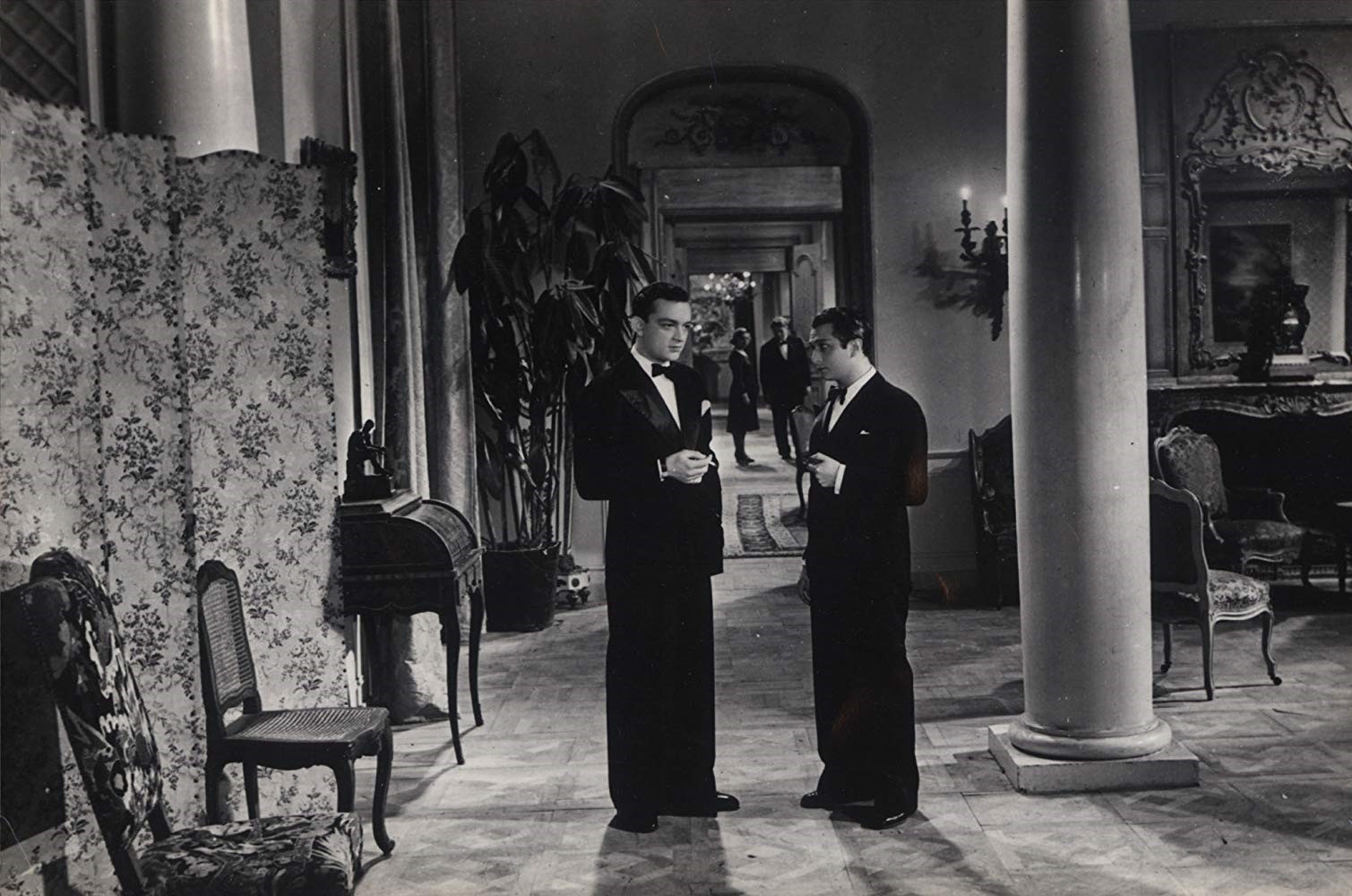 """Marcel Dalio and Roland Toutair in """"The Rules of the Game"""" (1939). Retrieved from  https://www.imdb.com/title/tt0031885/mediaviewer/rm883601920"""
