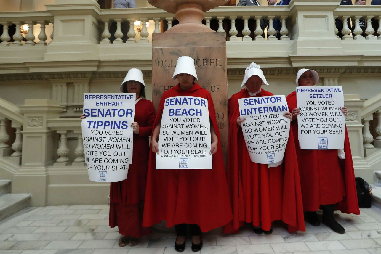 Women hold signs to protest HB 481 at the state Capitol on April 2 in Atlanta. Credit: AP. URL address:  https://nypost.com/2019/04/03/alabama-anti-abortion-bill-likens-legalized-abortion-to-the-holocaust/