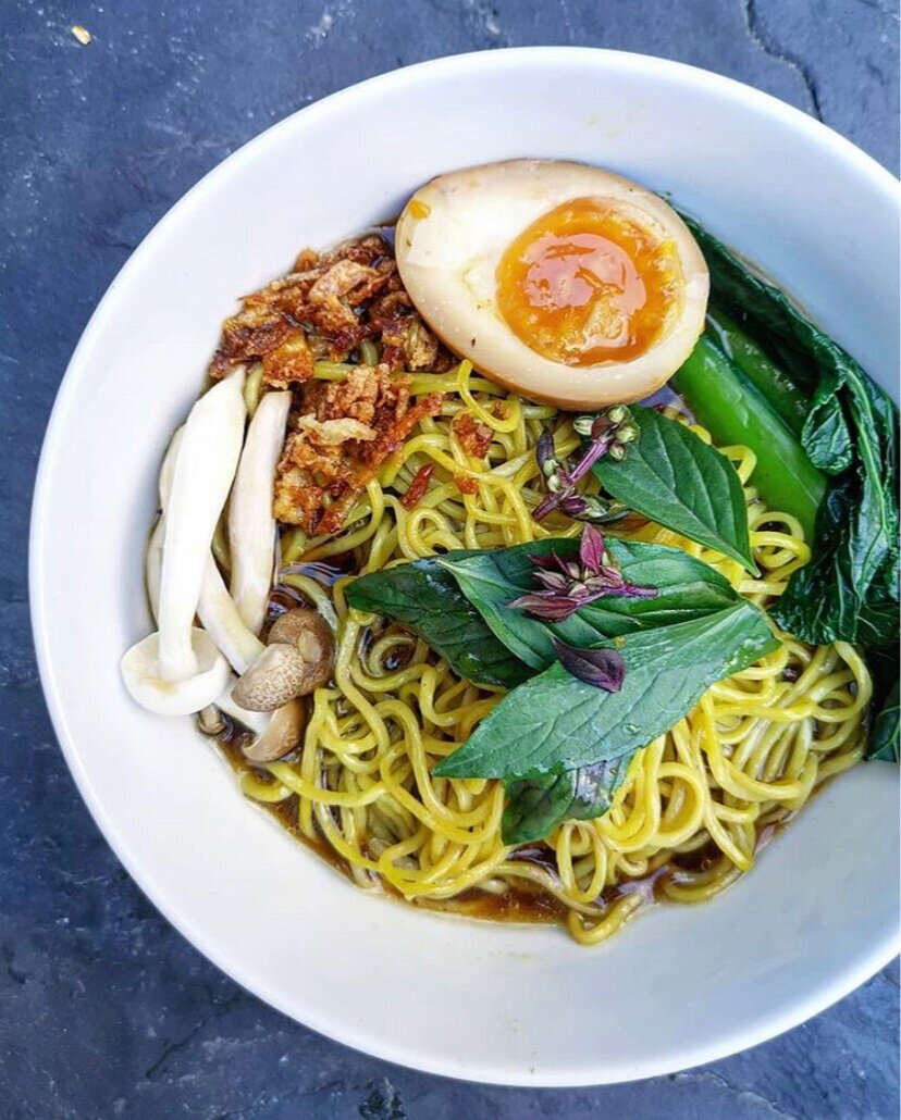 Aromatic Thai beef broth with hand made ramen noodles, kaffir lime leaf oil and a fudgy soy-cure egg from Pippy Muff Vol 1. Drool.