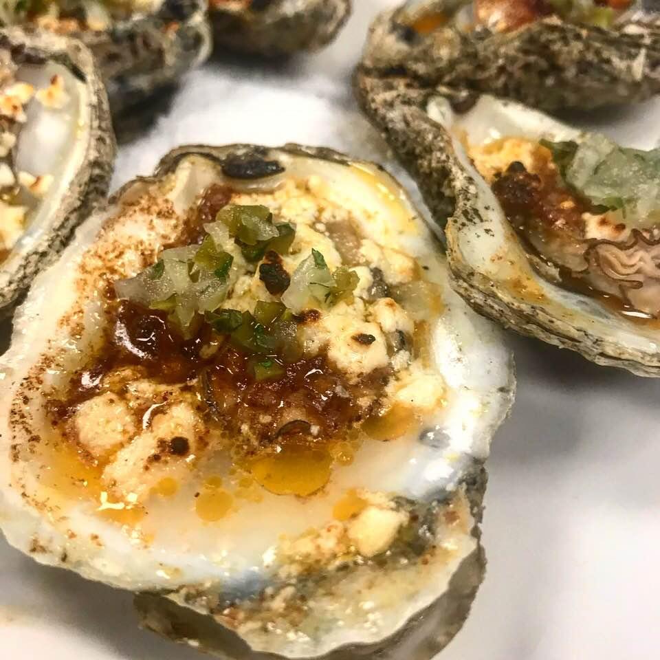 "Chorizo butter oysters ""Rockefeller"