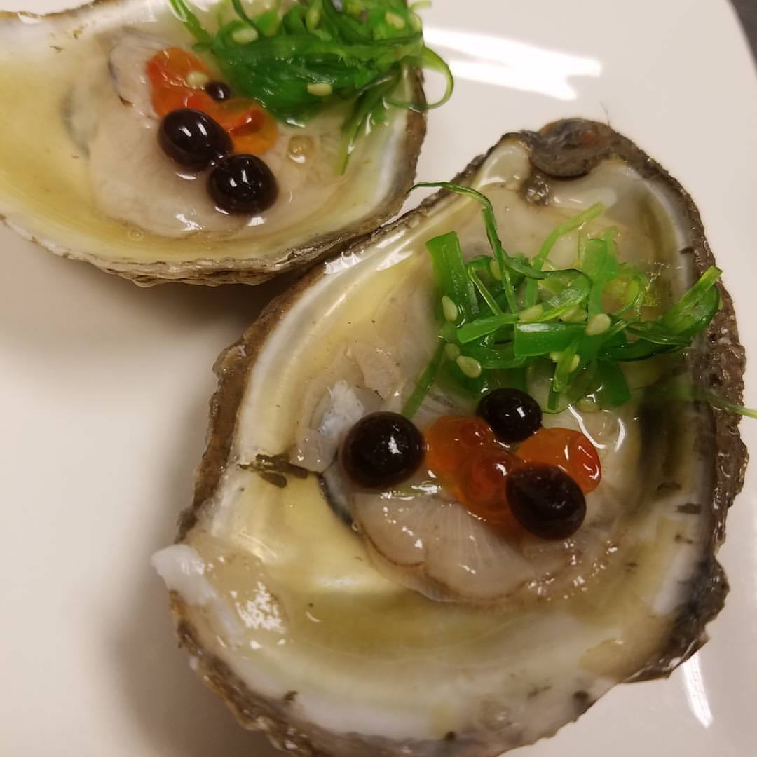 Lightly pickled oysters with salmon eggs and balsamic caviar