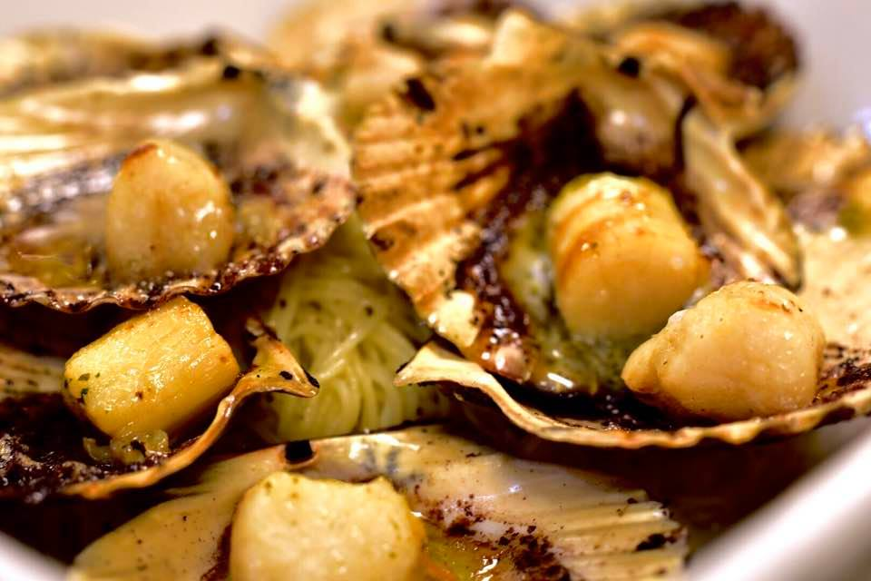 Maine's Buzzards Bay scallops broiled with a house maitre d hotel butter over angel hair pasta