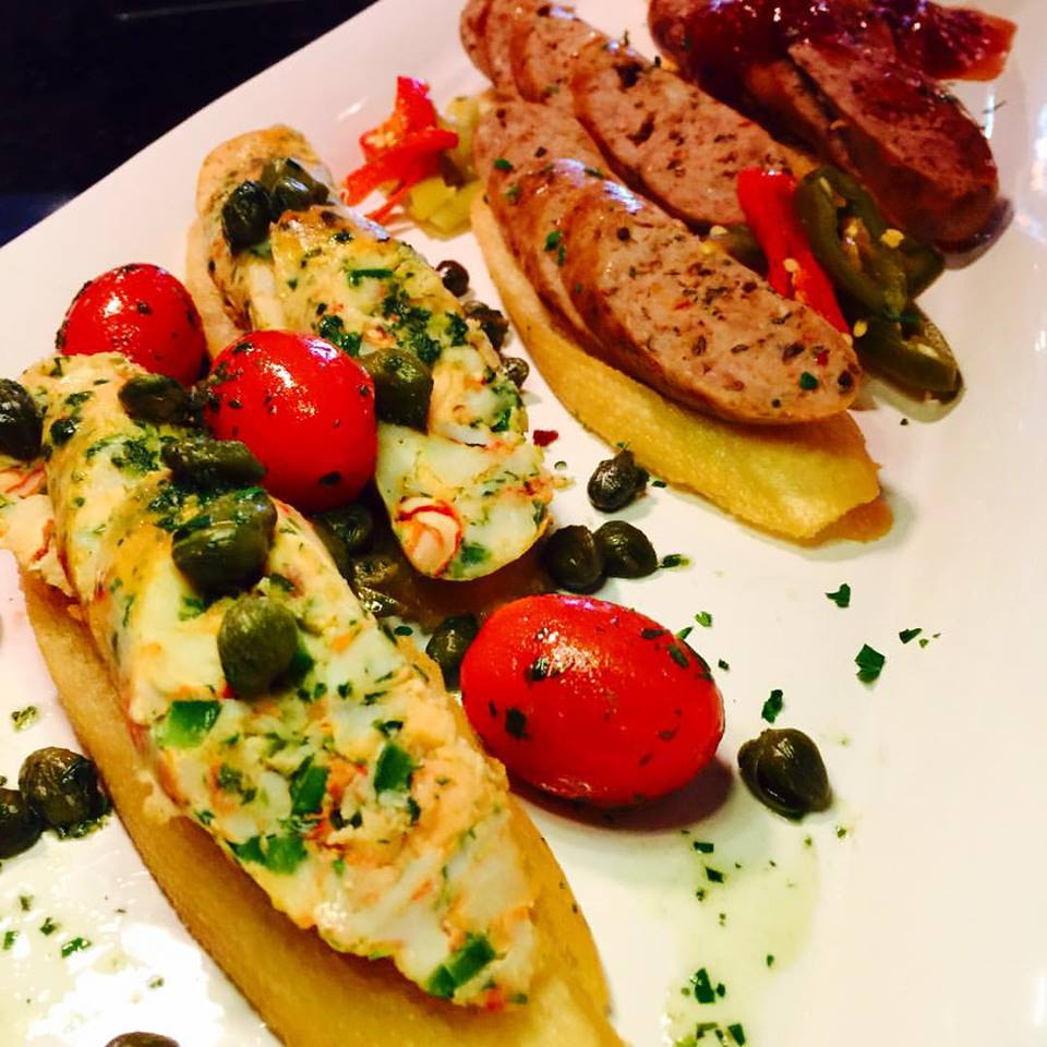 trio of housemade sausage - seafood with marinated local cherry tomatoes - Italian with local pickled hot peppers and #duck with local white peach moustard