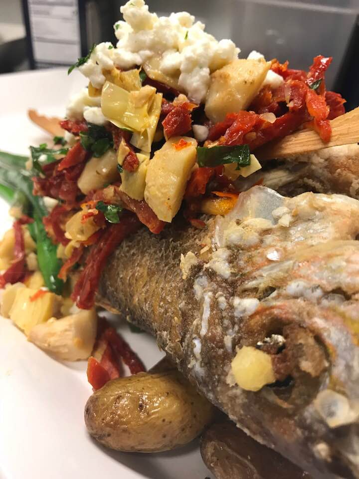 Whole fish topped with sun dried tomatoes, marinated artichokes, cherry peppers, roasted red peppers, and feta