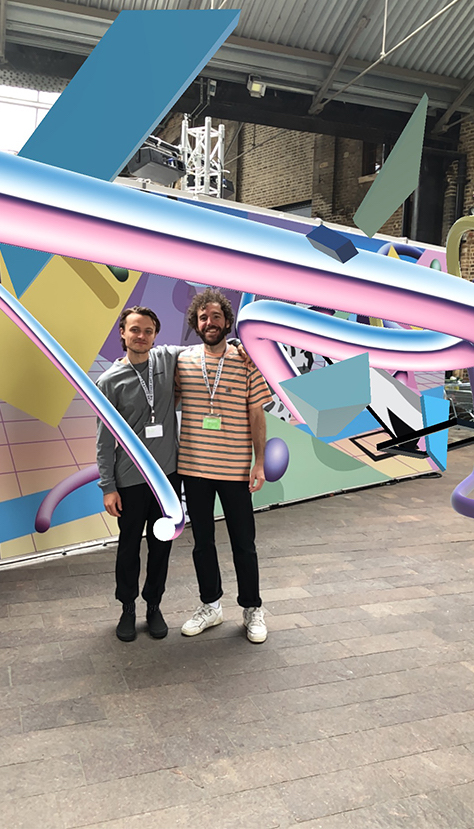 James Rogers (left) and Olly Fathers (right) in front of their mural  A Boom Downloaded From The Clouds , 2019Words by Arietta Chandris