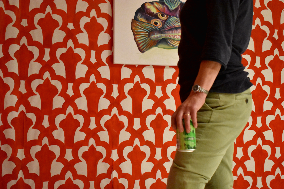 A visitor enjoying a can of American Pale in front of my painting, 'Fish'