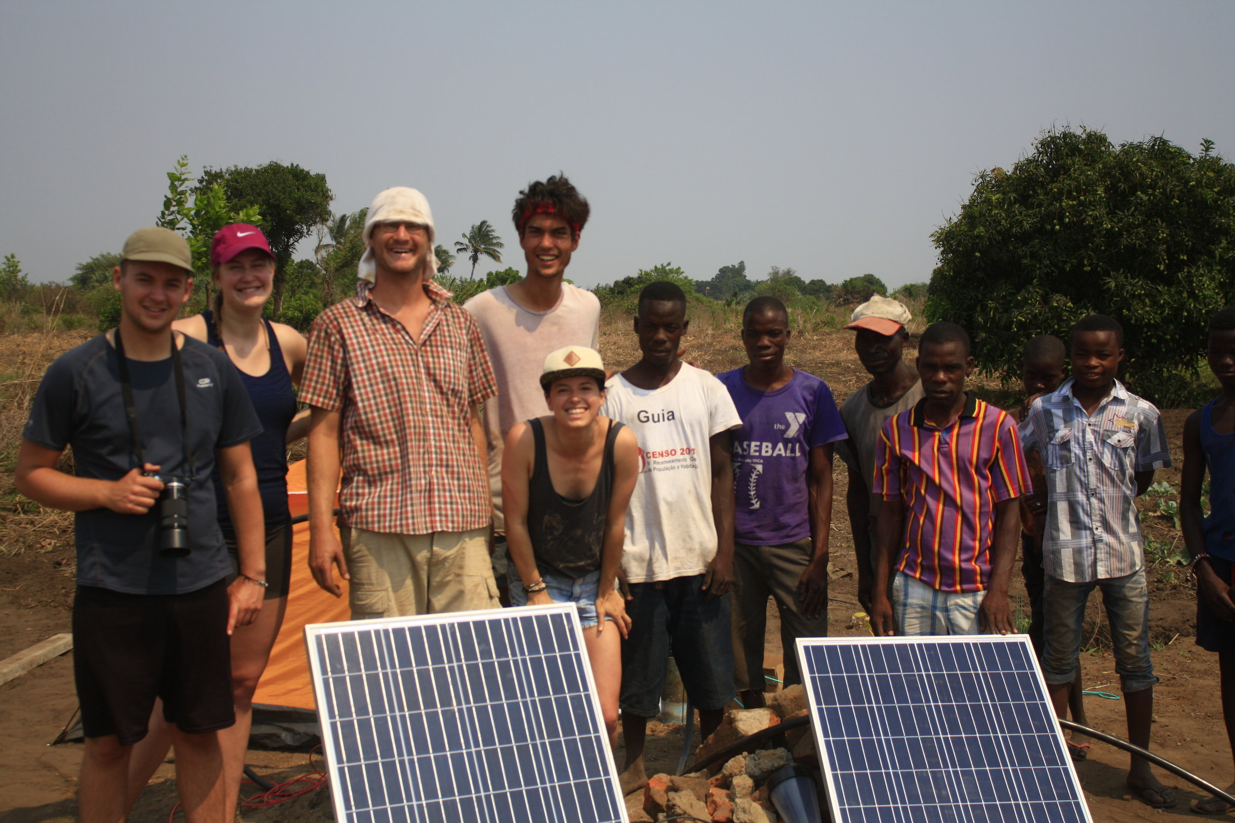 Zach with Solar Panel Installation Team.JPG