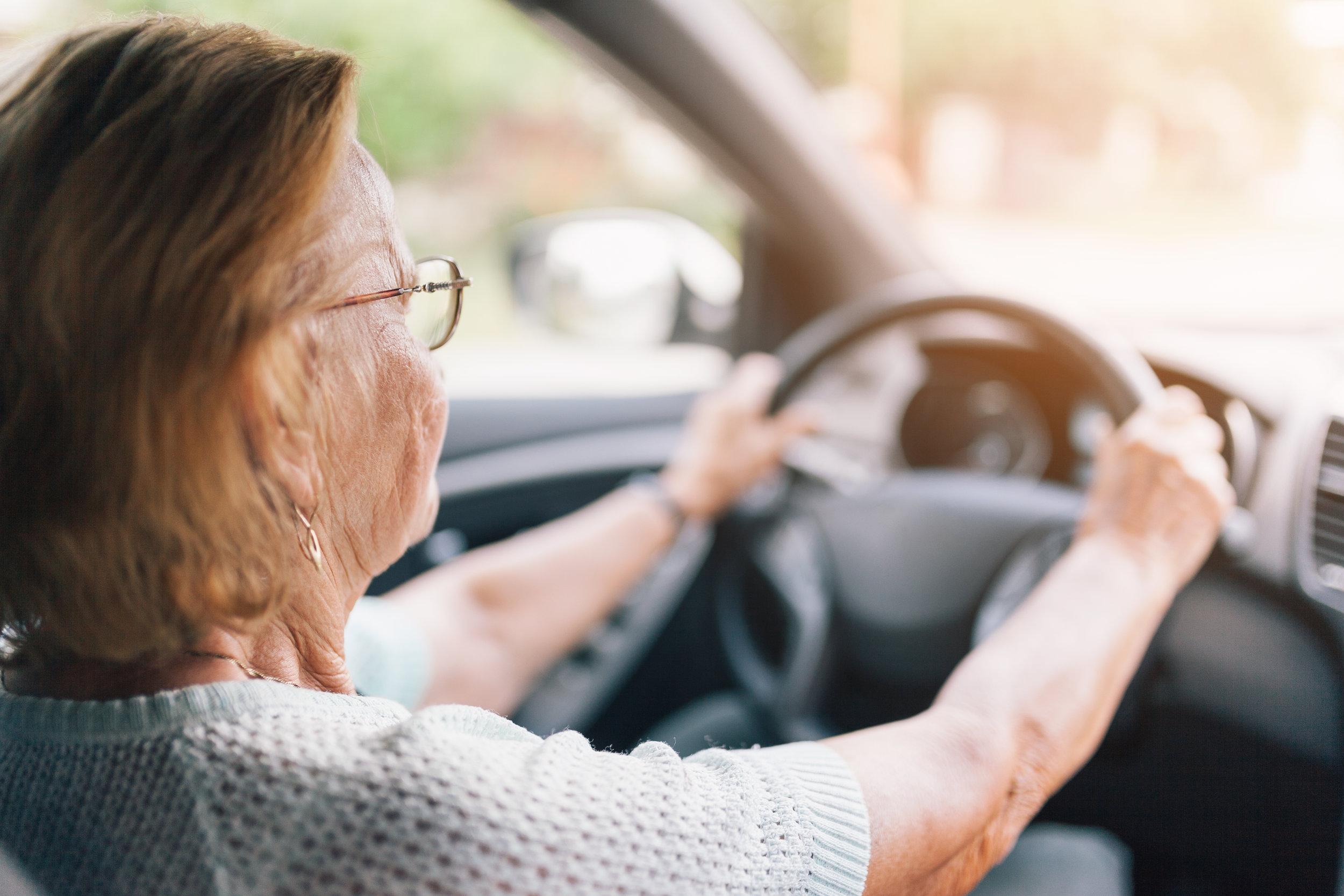 elderly-woman-behind-the-steering-wheel-R2CNUJ4.jpg
