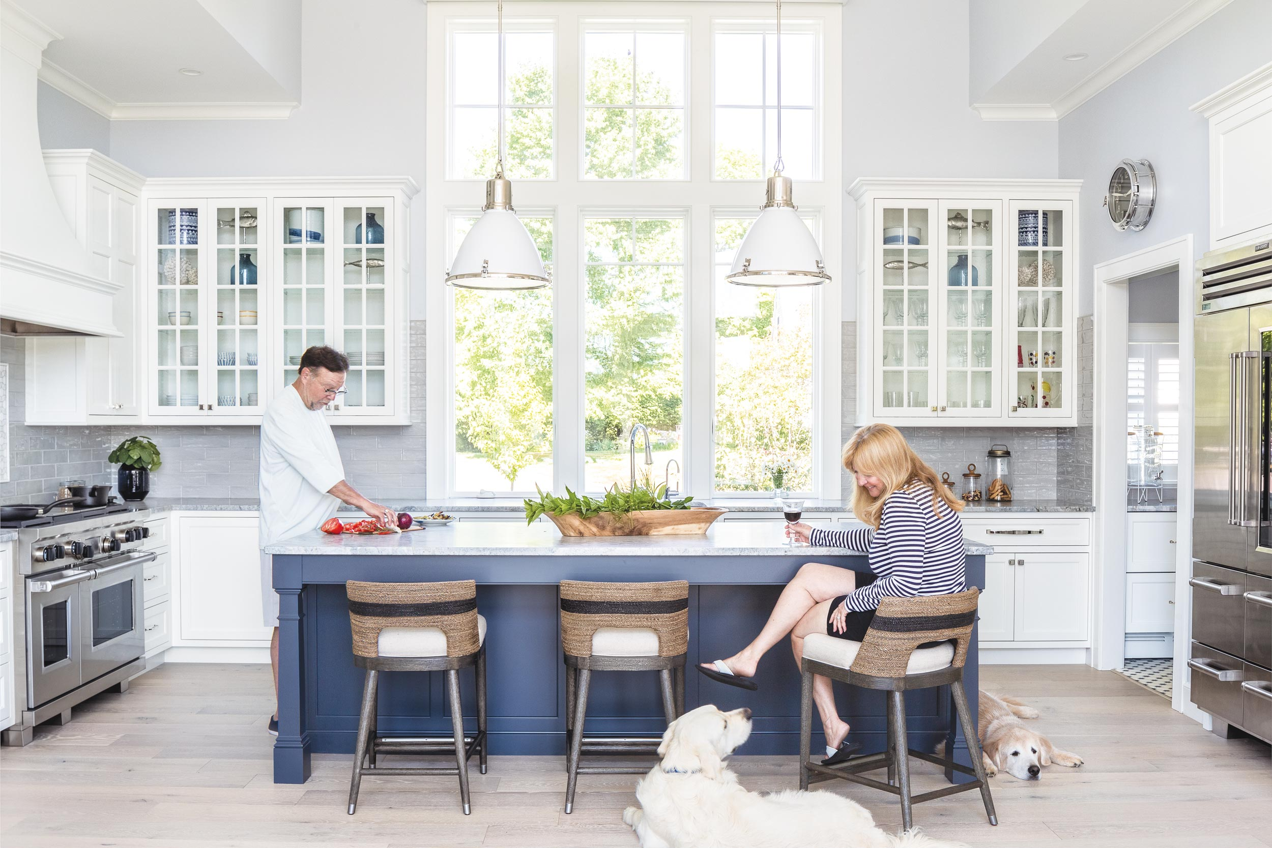 """Cooking for four. Ample kitchen space allows plenty of room to enjoy """"the slow life,"""" as Ms. Nash calls it, with their beloved retrievers Chappie and Samson."""