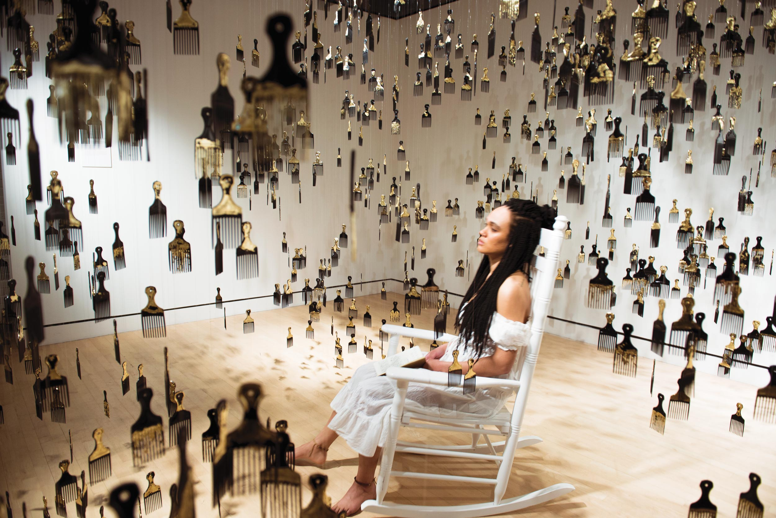 ELEANOR KIPPING   Strange Fruit, 2018, installation and performance, afro picks, gold leaf, rocking chair, book of poetry, performance by artist