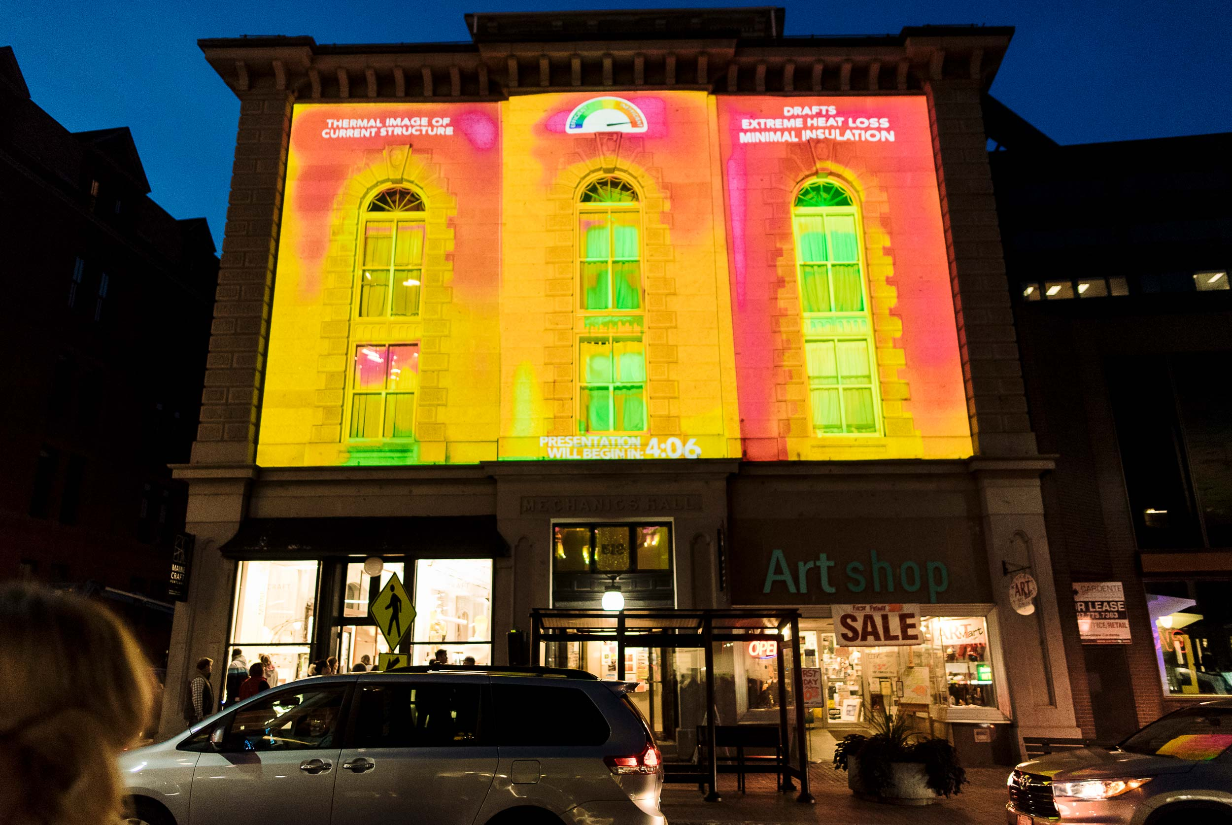 The passivhausMAINE event, made possible in cooperation with The VIA Agency, Headlight Audiovisual Inc., and MECA, combined thermographic images, playful animation, and music to create a festive and infor mative display. The thermographic imaging demonstrated the heat loss experienced by Mechanics' Hall.
