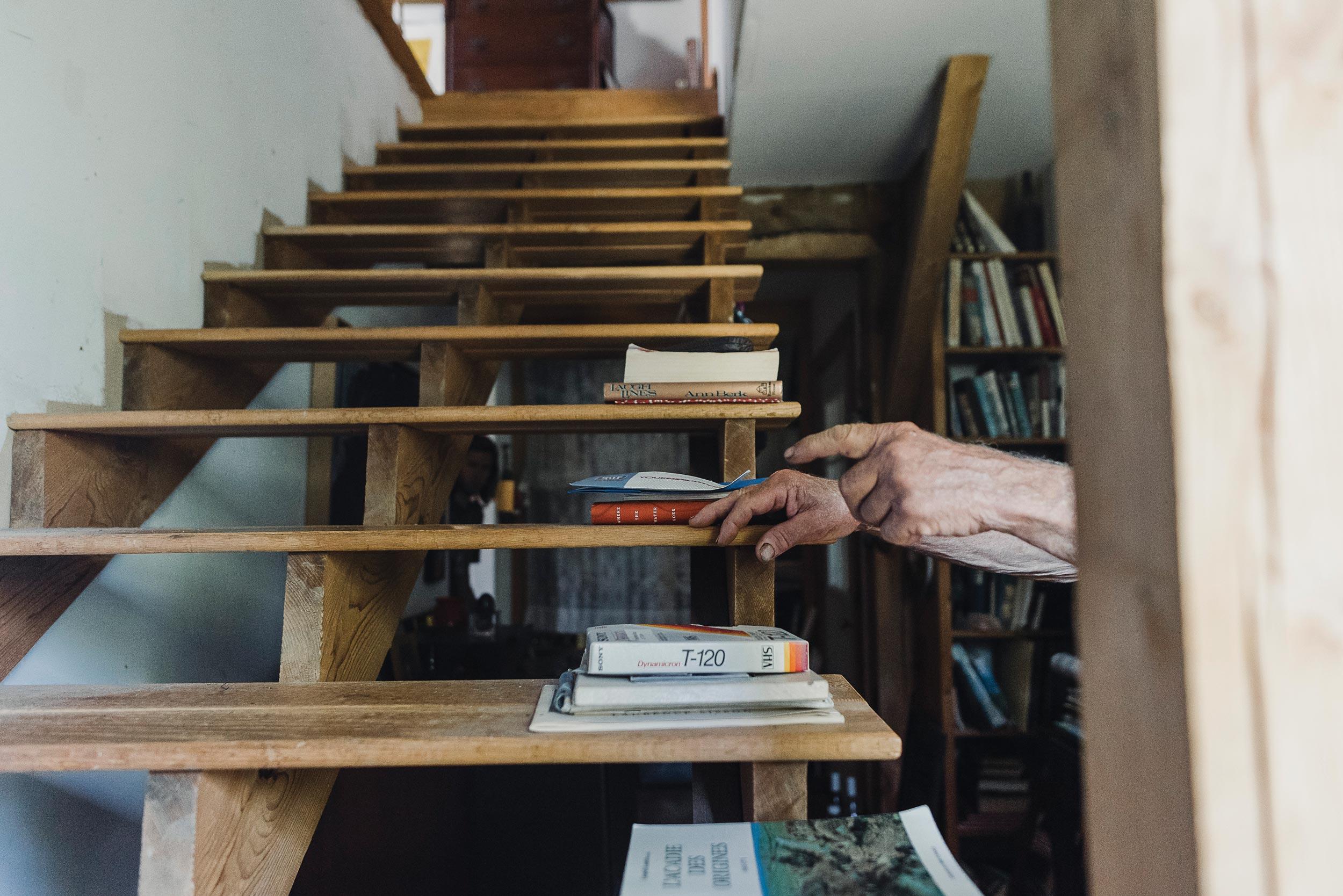 The stairs leading to Denis's attic-level art studio.
