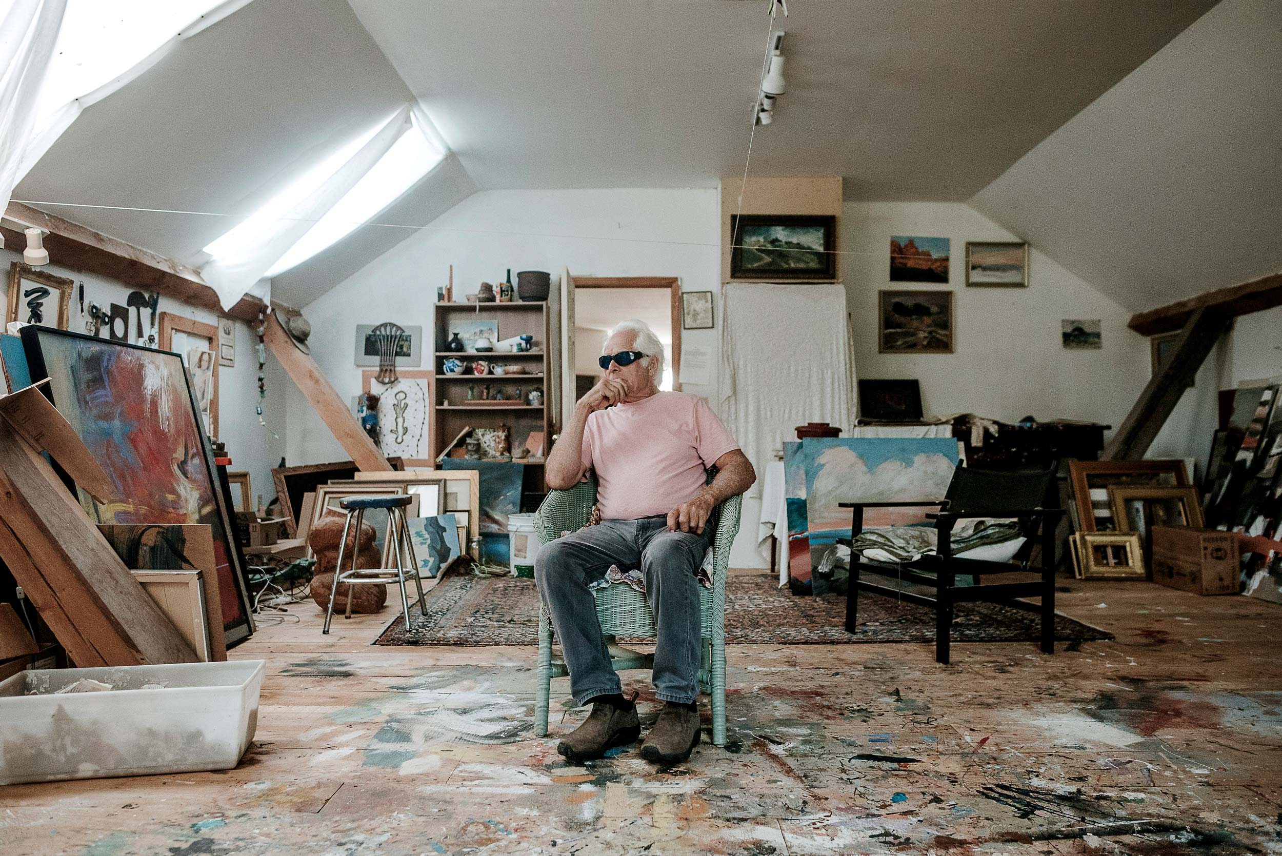 The wide-planked floor of Denis's studio is a melange of paint smears, splashes, and dribbles, a kaleidoscope mishmash of color that looks like a work of art itself.