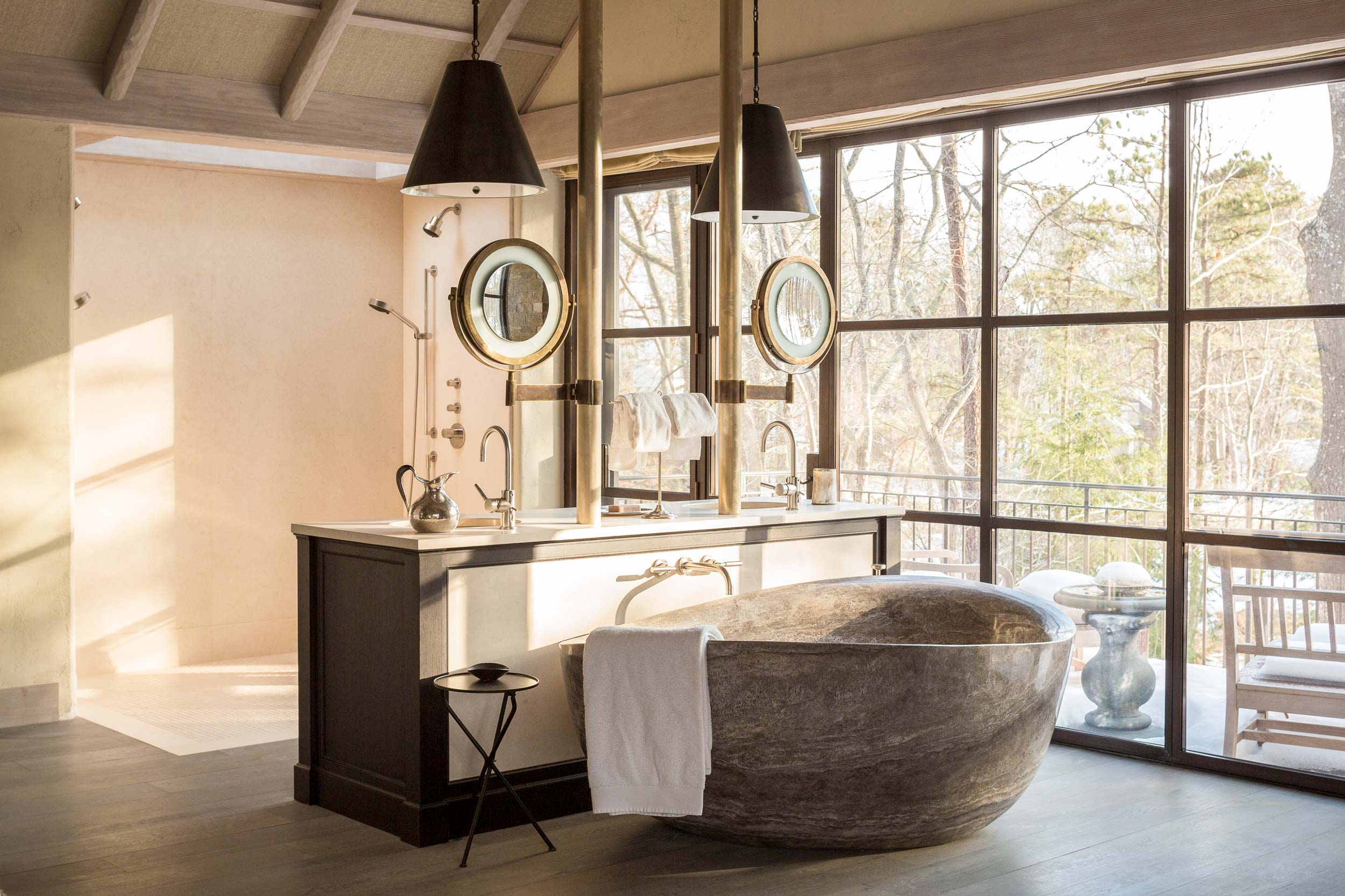 """Installation of the master bathroom tub required intricate planning and the use of a crane. """"It is as much an art piece as a place to soothe my body and soul,"""" Jennifer says."""