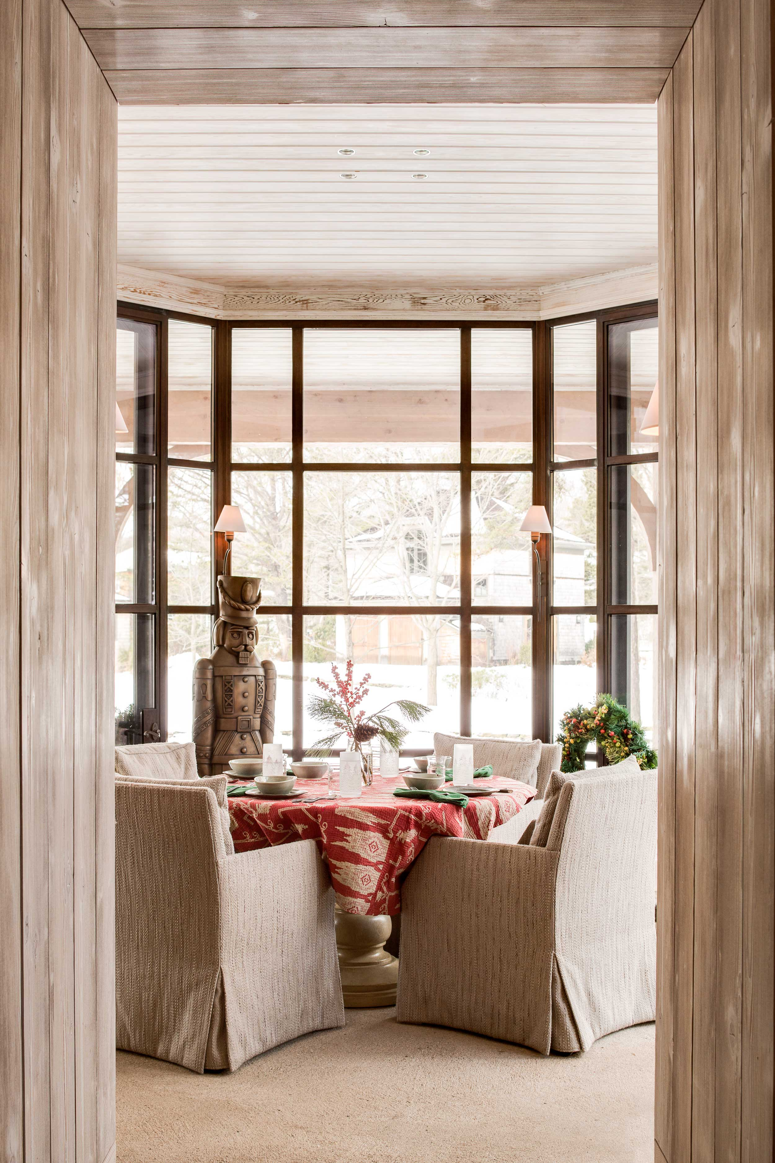 """The Octagon Room just off the kitchen seats six for breakfast and boosts Jennifer's efforts to """"bring the outside in."""""""