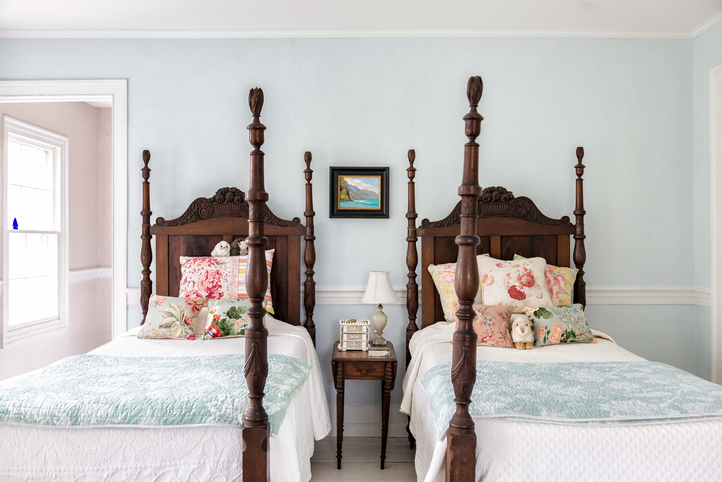 In the upstairs guestroom are ornately carved antique twin-poster beds inherited from John's grandparents