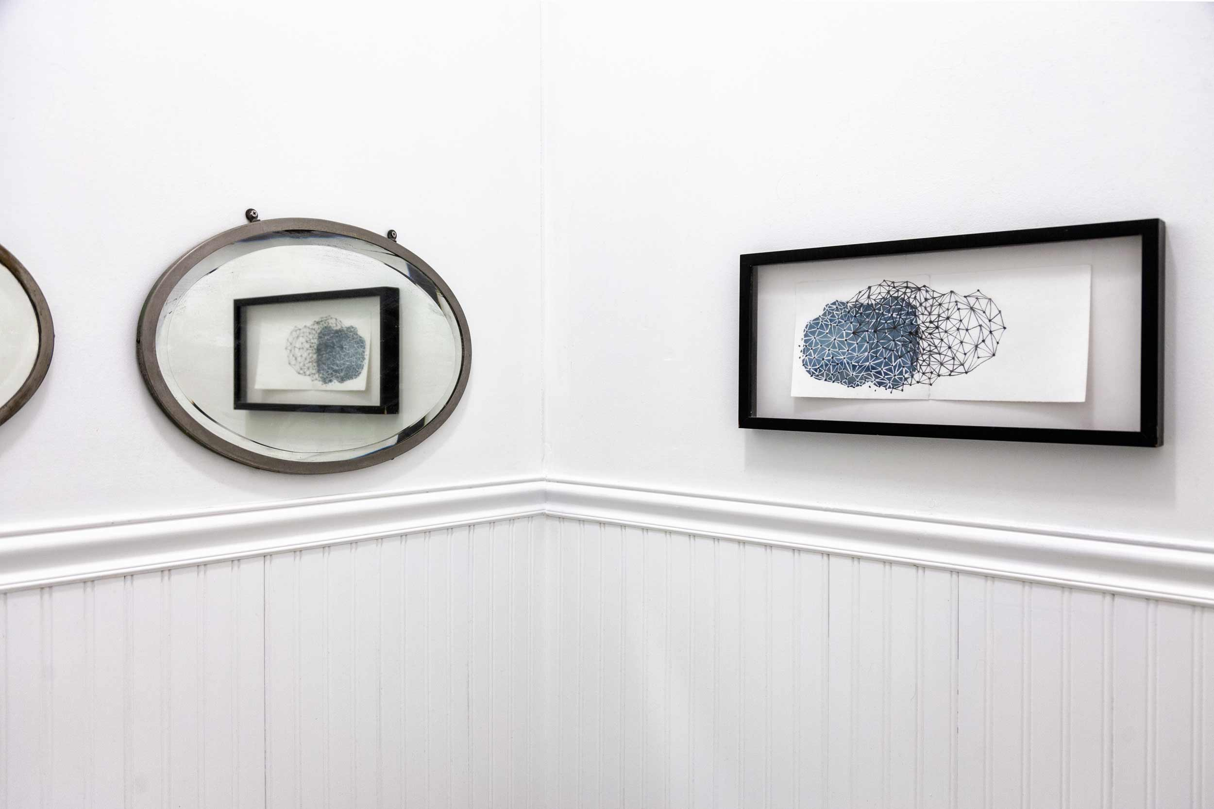 In the guest bathroom, a vintage mirror and a drawing by Anna Hepler.