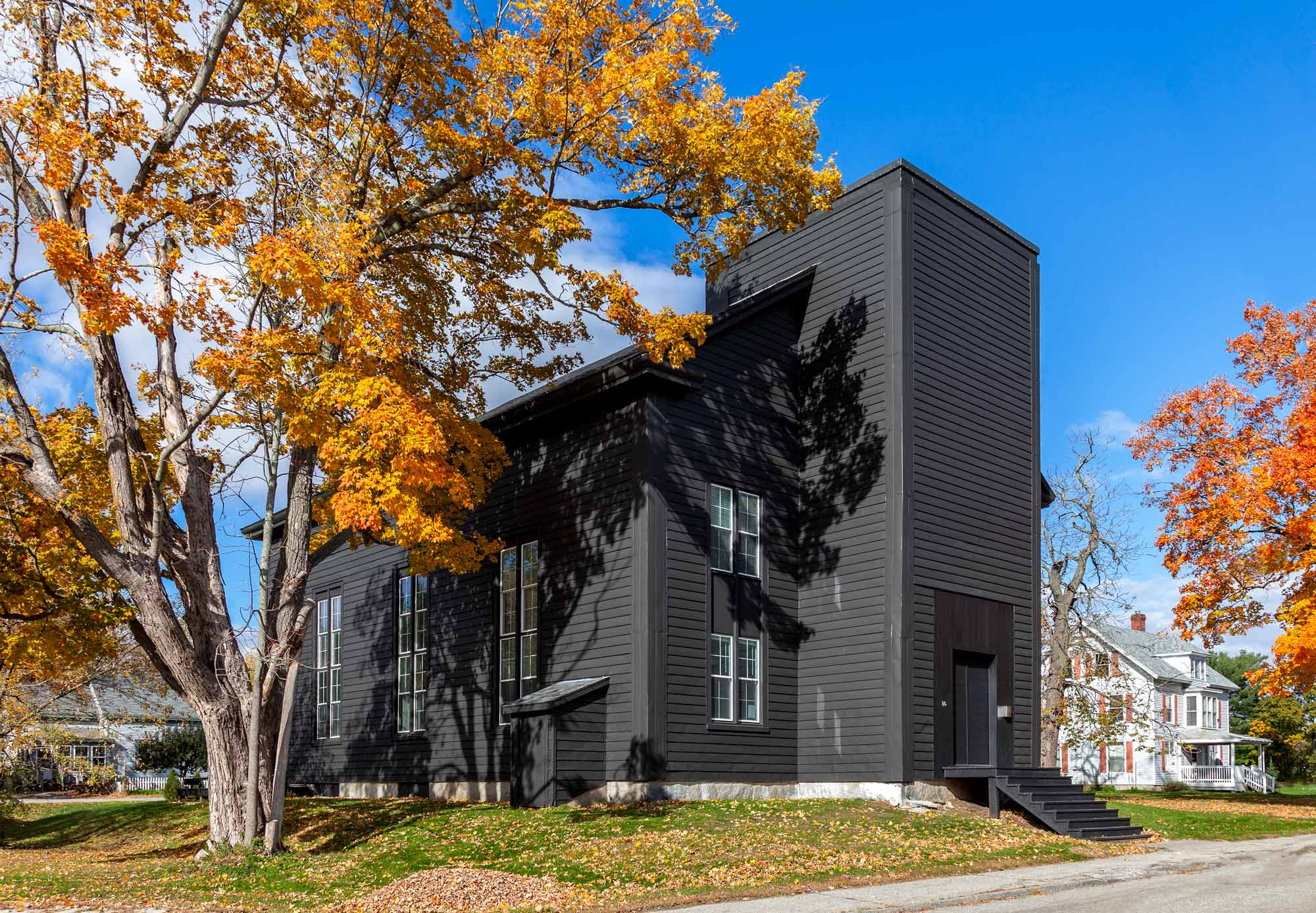 The exterior of the church, once white, McNeil had painted black, inspired by the look of Japanese fermented soot paint.