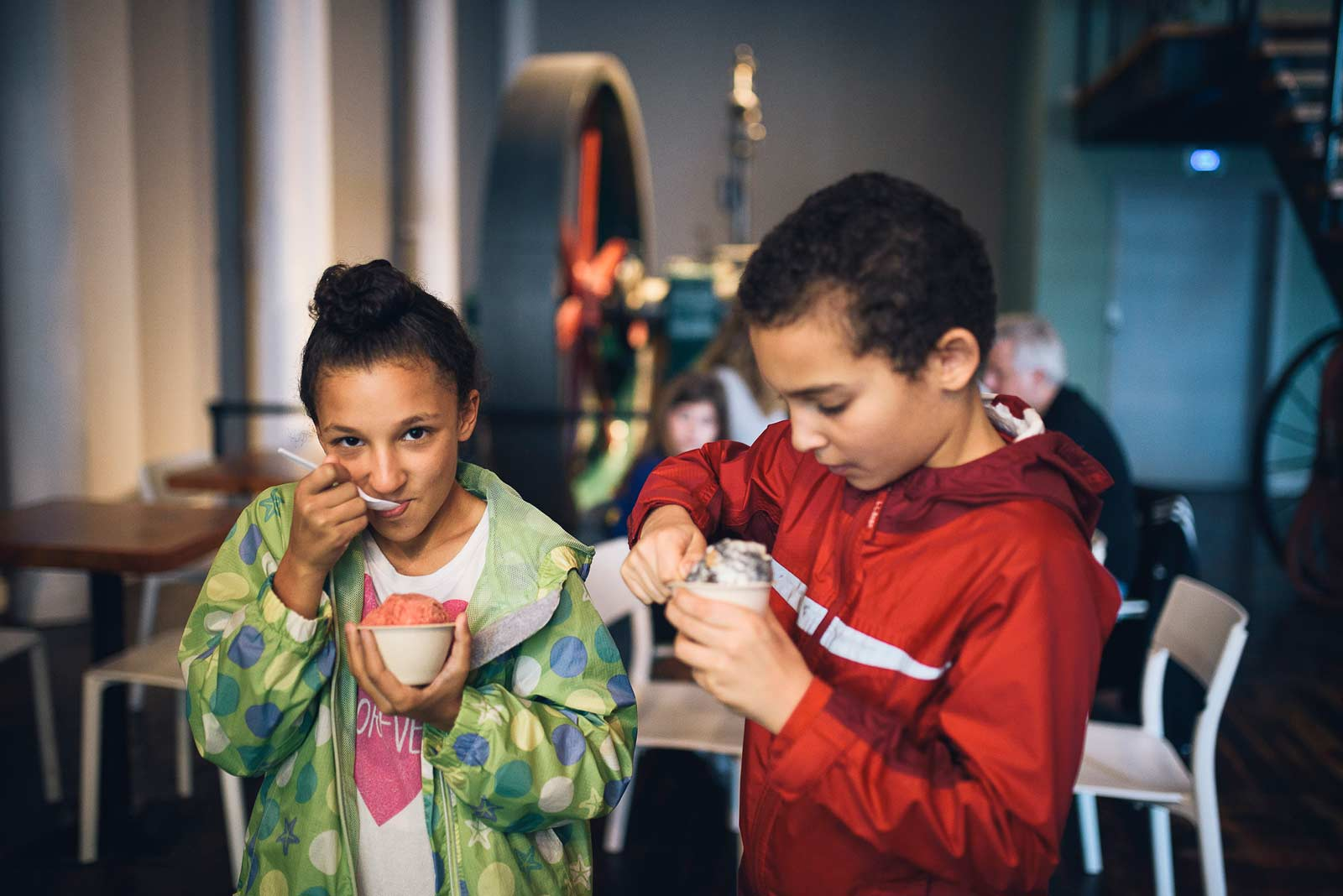 Siblings Maya and Balam Serrano dive into treats from Sweet cream Dairy at the Pepperell Mill.