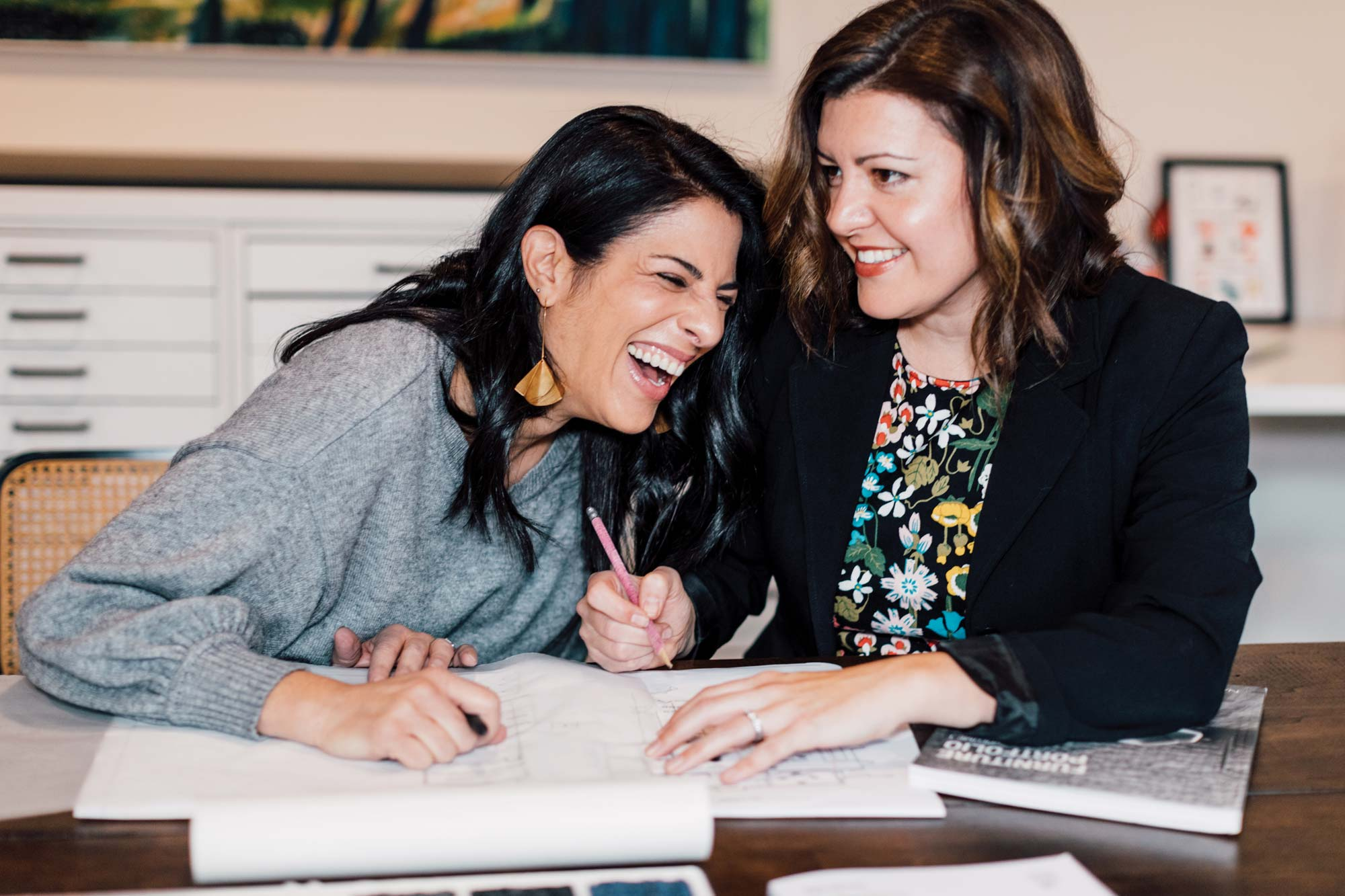 Zoulamis and Scamman share a laugh. The partners have a lighthearted rapport that makes all their hard work look easy.