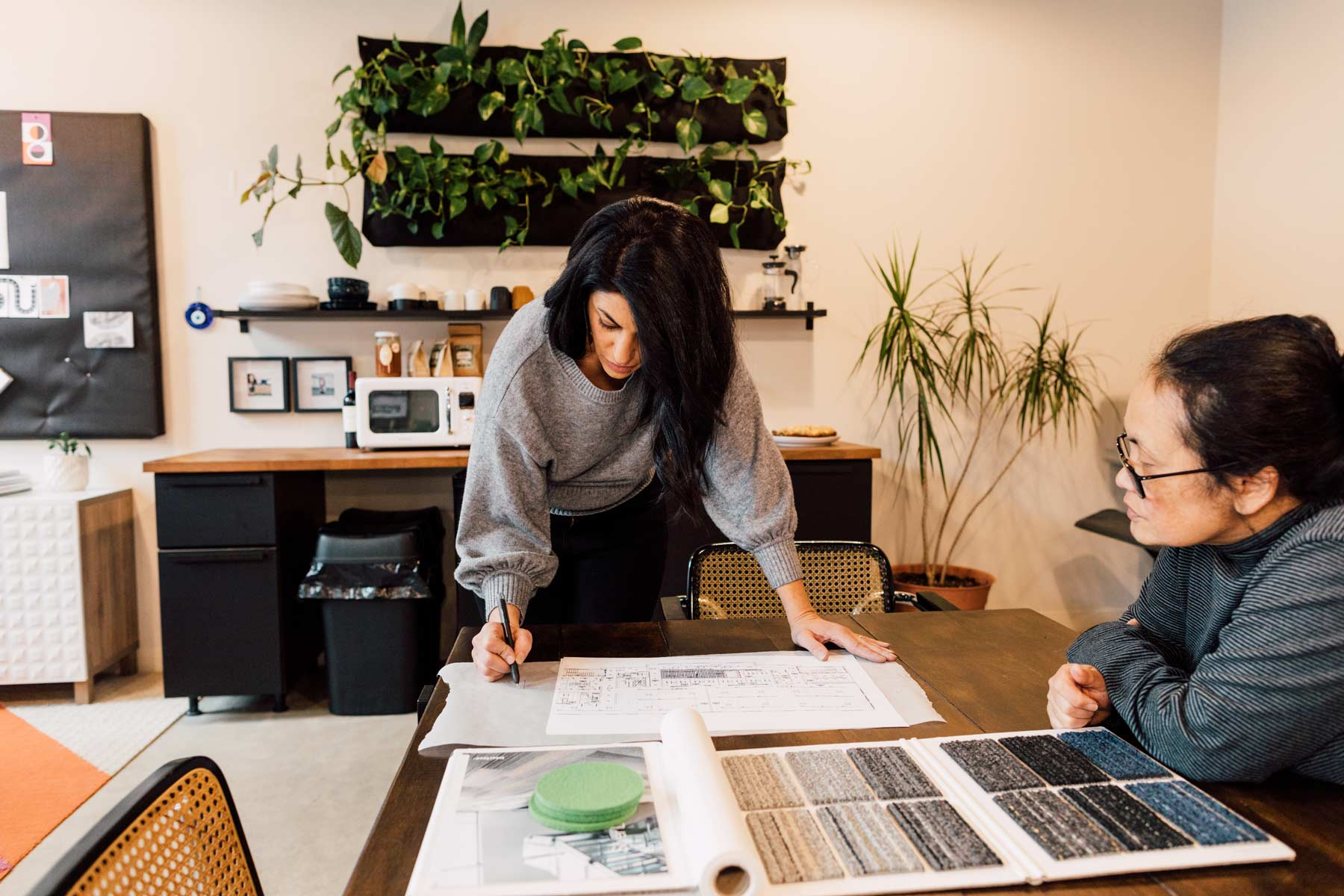 Zoulamis works on a project with Bowerbird's draftsperson, Judith Bernier.