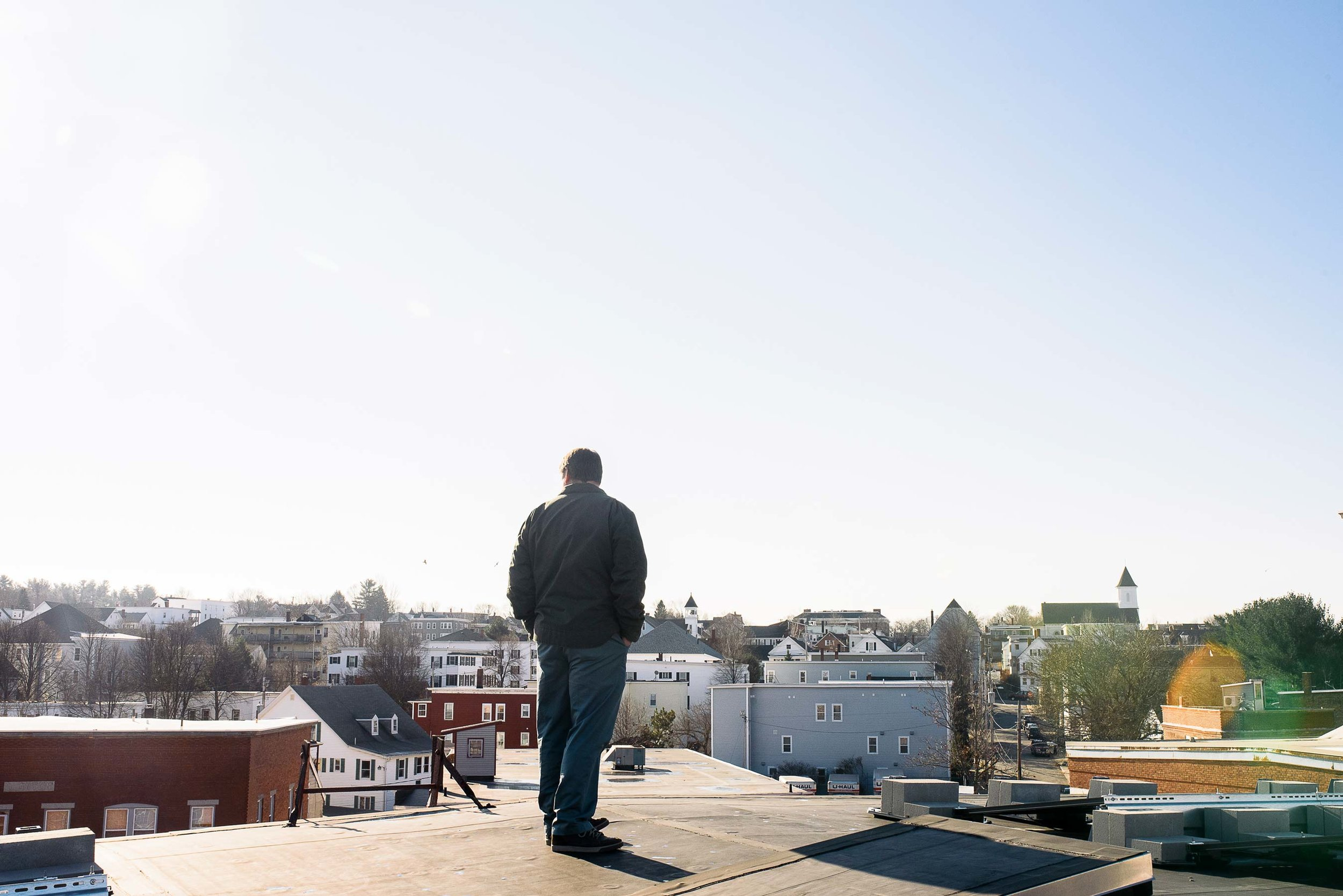 """Scott Joslin surveys downtown Biddeford from the roof of the Pepperell Mill. Says Joslin of the project, """"It's an opportunity to prove that solar energy can work, and we want to showcase it."""""""