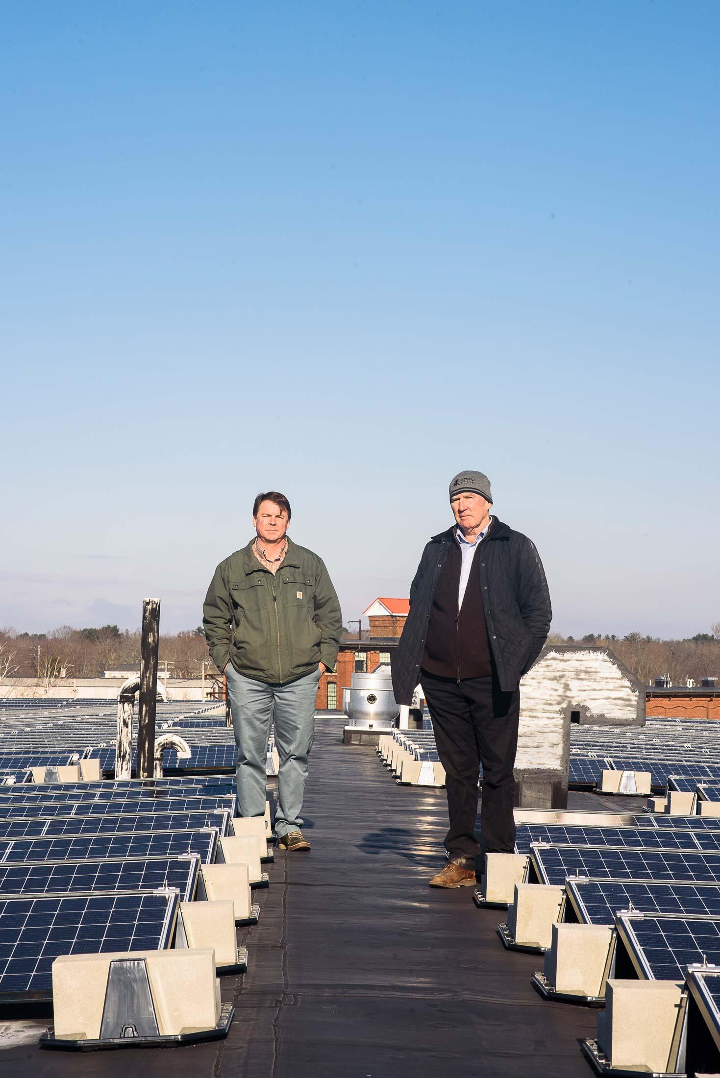 "COO Scott Joslin (left), and CEO Doug Sanford (right), beside the solar array. Johanna Sorrell, of ReVision Energy, calls the pair ""visionary."""