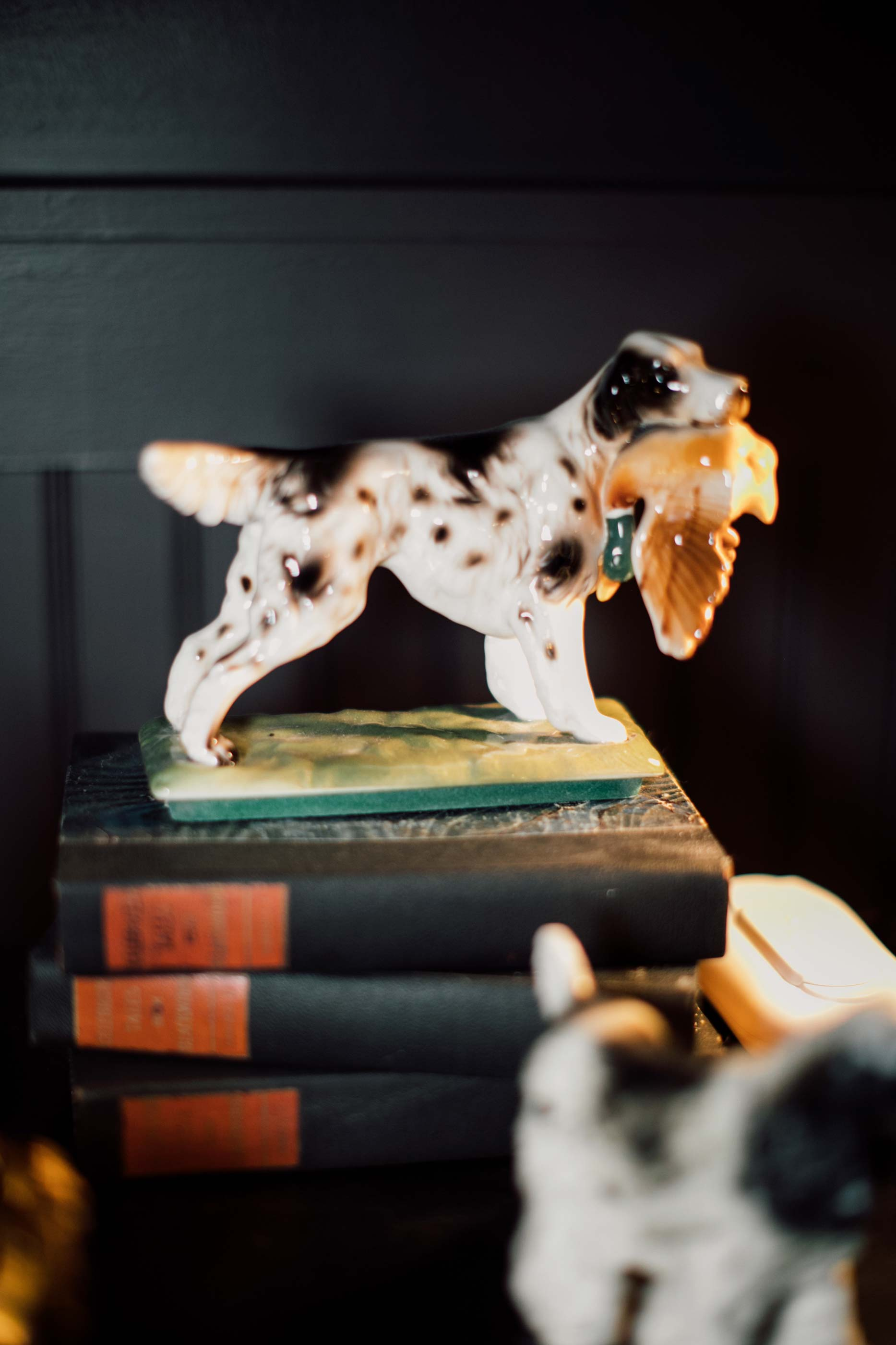 """One of the many vintage dog figurines found by Stokes. While collecting dogs for the project she became ver y particular. Not just any old dog would do. """"I became a dog statue connoisseur,"""" she laughs."""