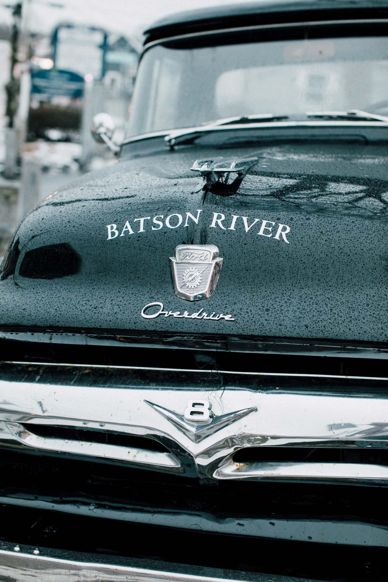 The Batson River Tasting Room logo, by Hugh McCormick Design Co., on the hood of a classic Ford Overdrive pickup truck.