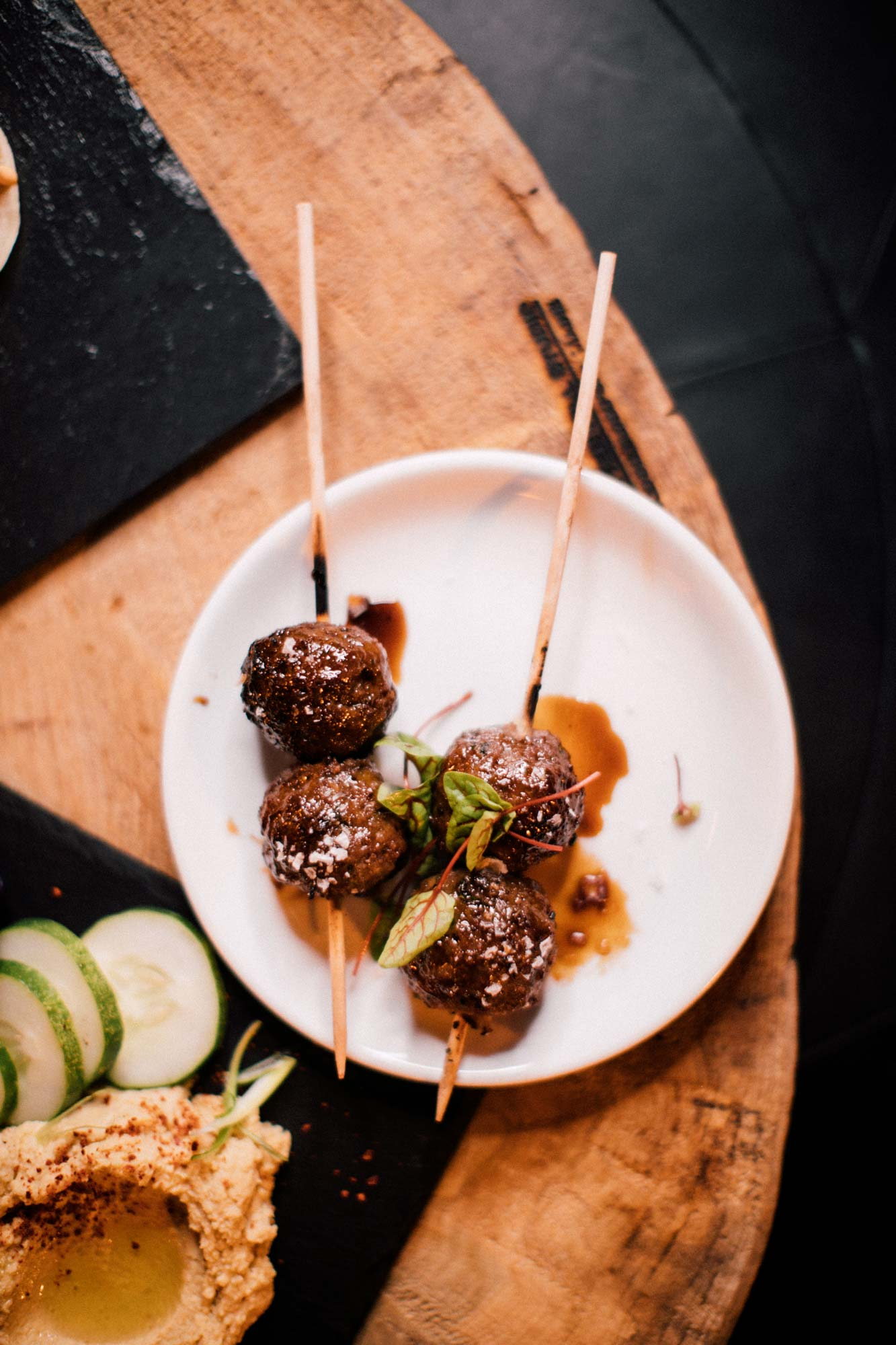 A small-plate of Beer-basted Meatball Skewers.