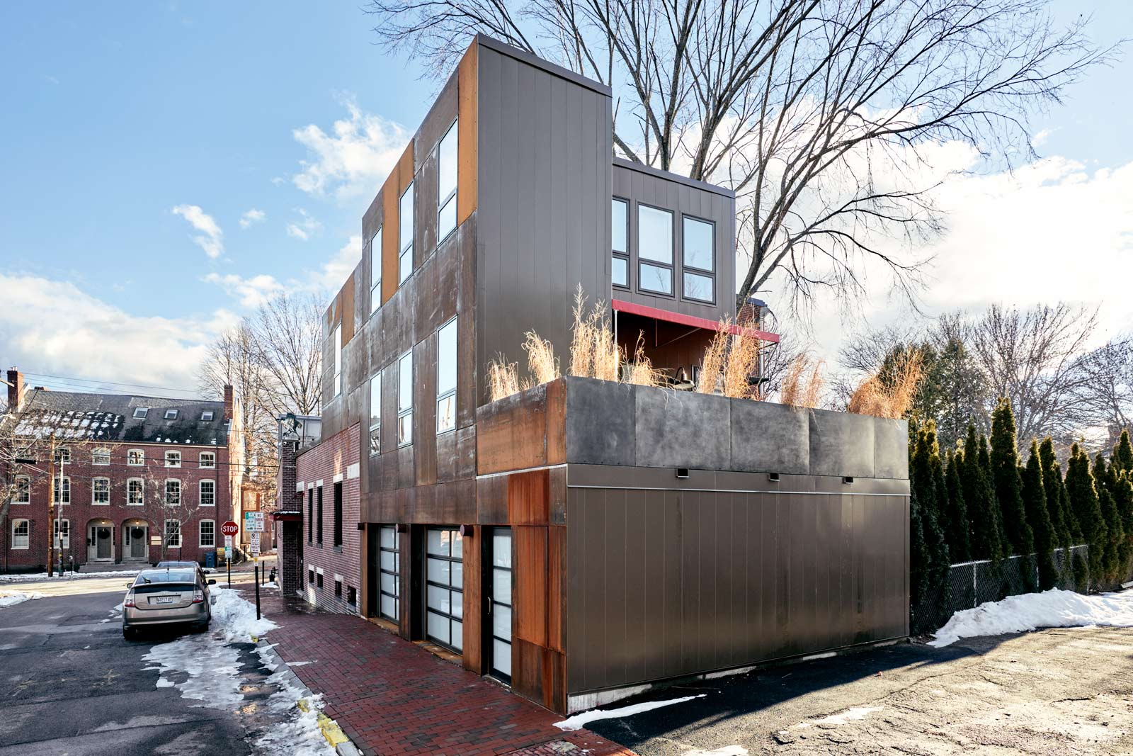Corten steel panels cover the South Street façade. Over time, the rust will blend with the red brick of the neighborhood. Because of a special treatment, the rust on corten steel protects rather than corrodes.