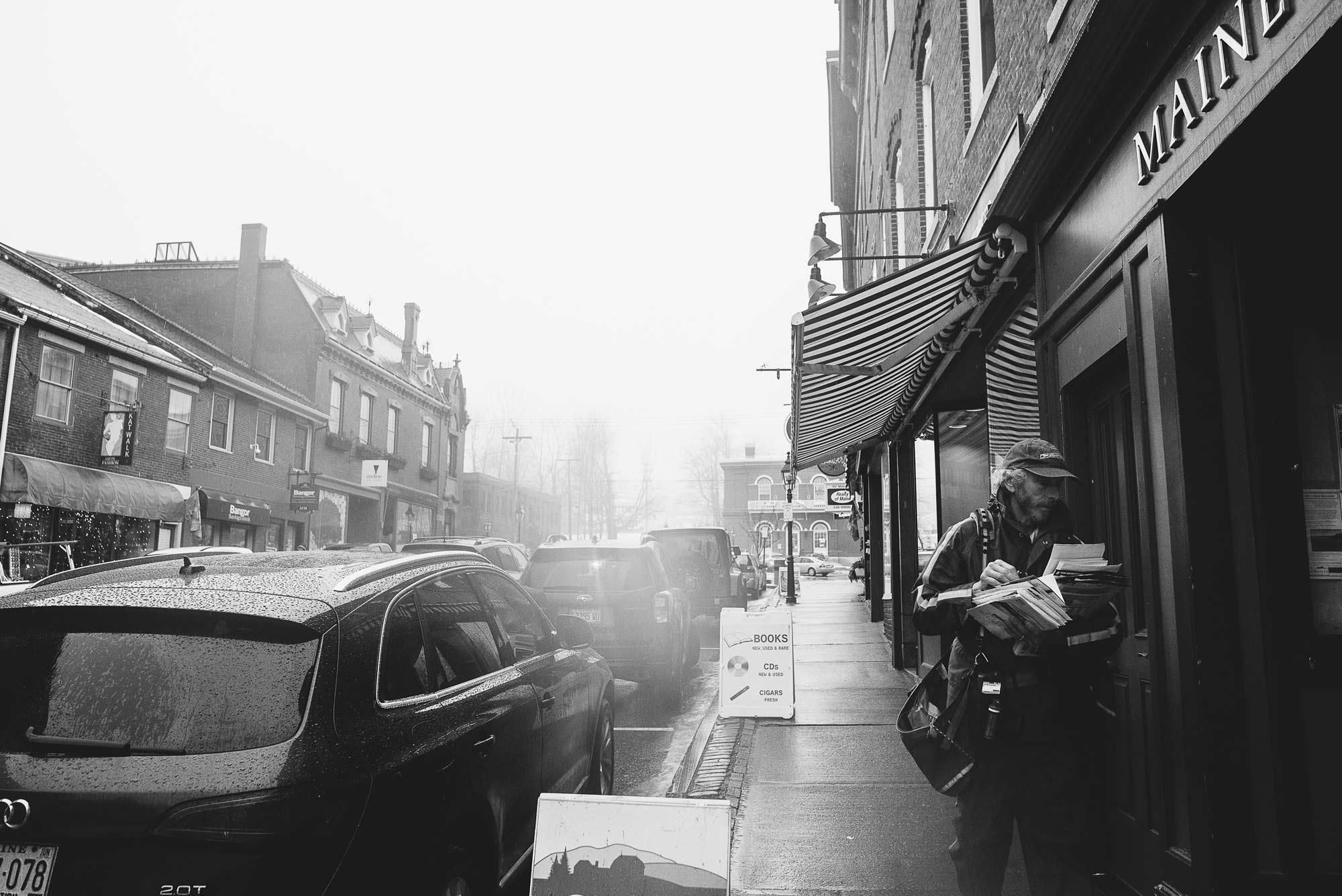 Main Street, Belfast, under the awning of Old Professor's Bookshop.