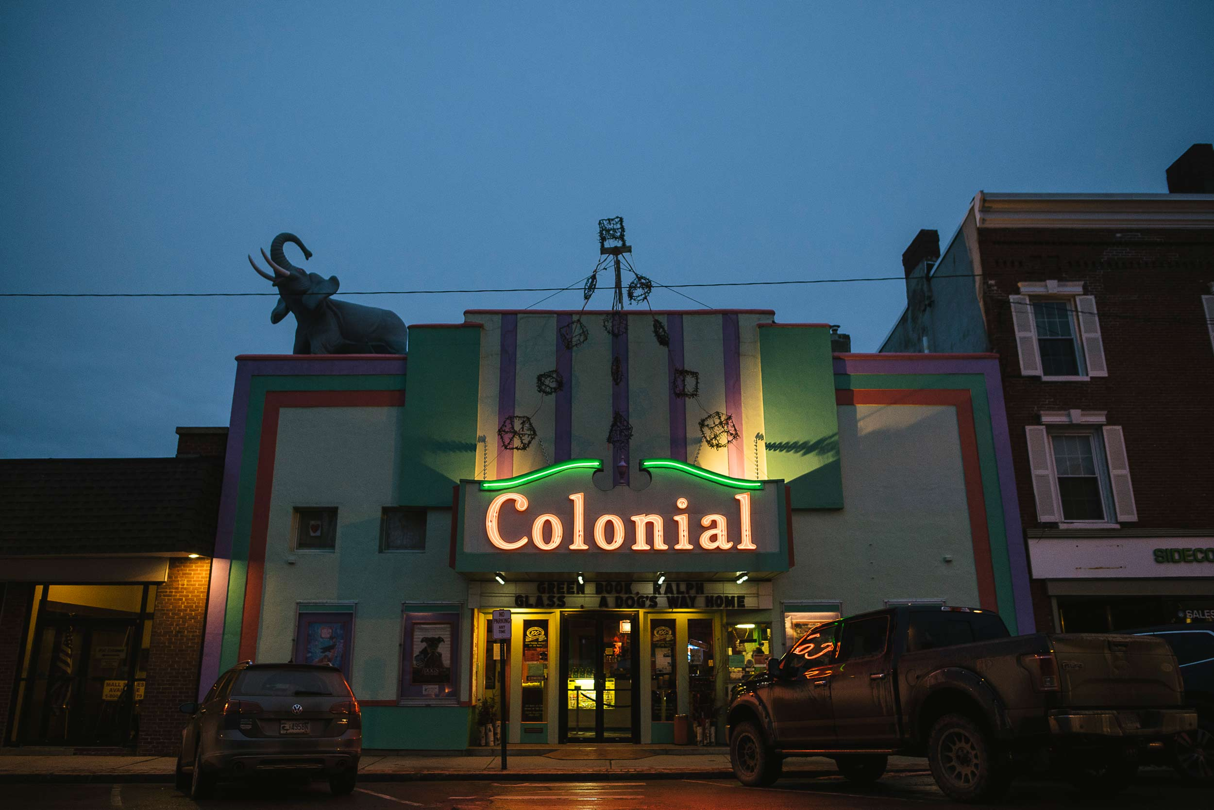 The show starts on the sidewalk with the Colonial Theatre's neon marquee and Hawthorne the elephant trumpeting above High Street.