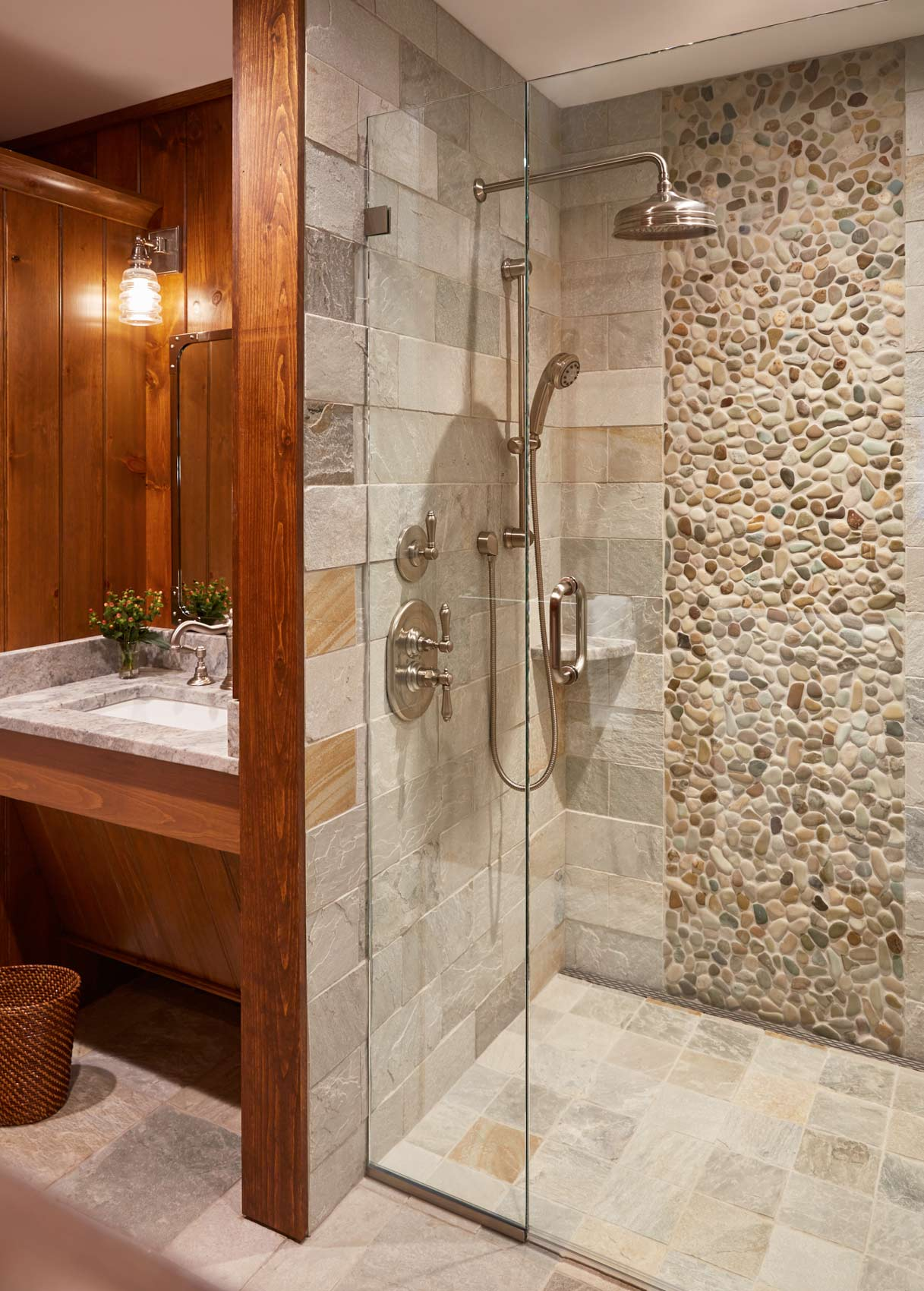The bathroom features a custom tile shower from Distinctive Tile & Stoneworks, designed by Sarah Welch of Hurlbutt Designs.