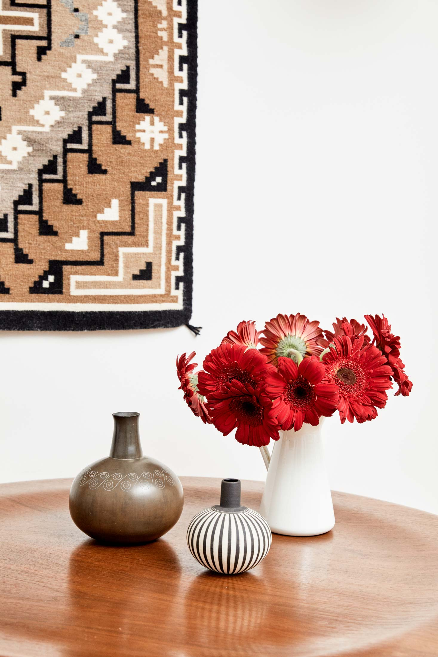 A contemporary Peruvian vase (left) sits on an Eames molded plywood coffee table in Werber's study.