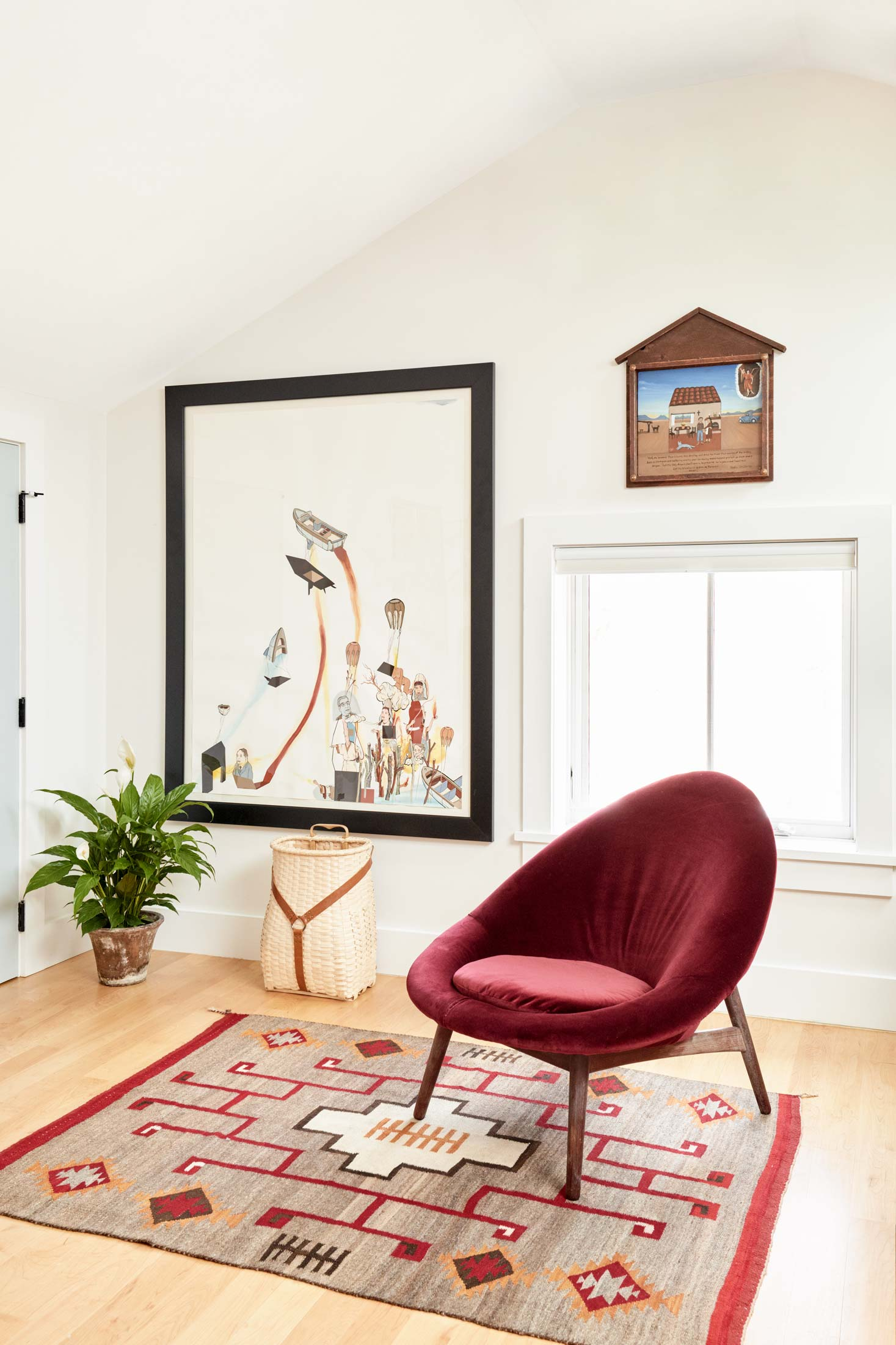 Fischer recovered the midcentury Danish chair in Beverly's study, which sits on a Navajo weaving circa 1930s. In the background is a contemporary pack basket by Wabanaki weaver Gabriel Frey and an ex-voto (over the window) by Neda Contreras with a prayer for protection of the Werber/Goldman home.