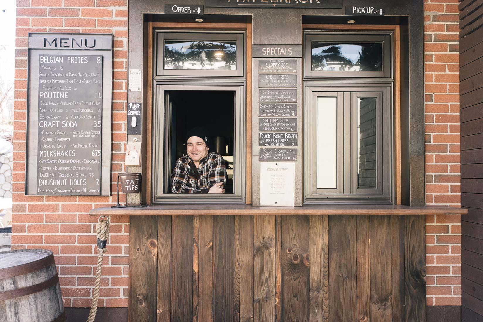 In the beer garden at Oxbow Blending & Bottling, Duckfat Friteshack's walk-up fry window is modeled after similar setups in Belgium and Amsterdam.