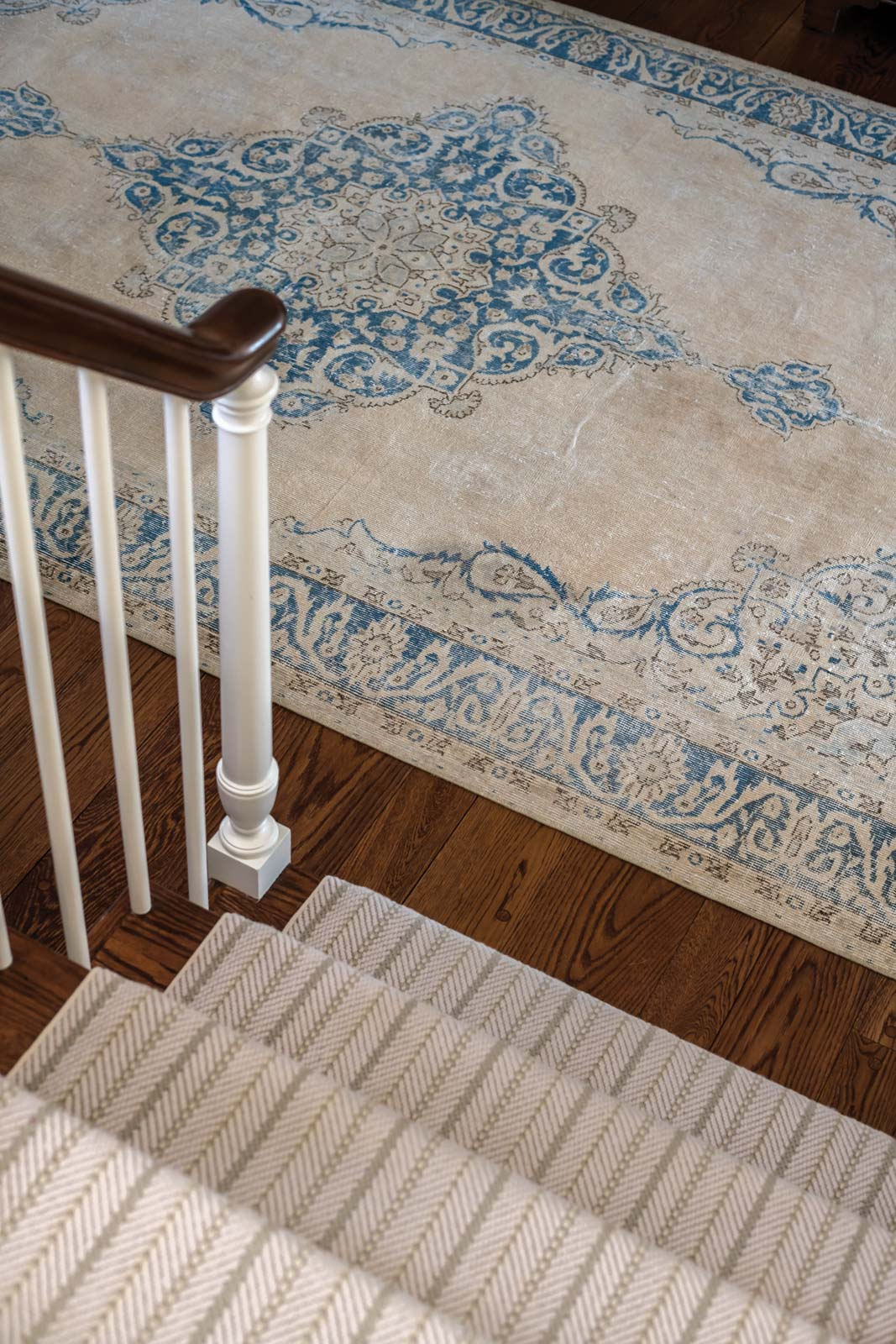 At the foot of the stairs, a vintage washed Persian rug from Simply Home.