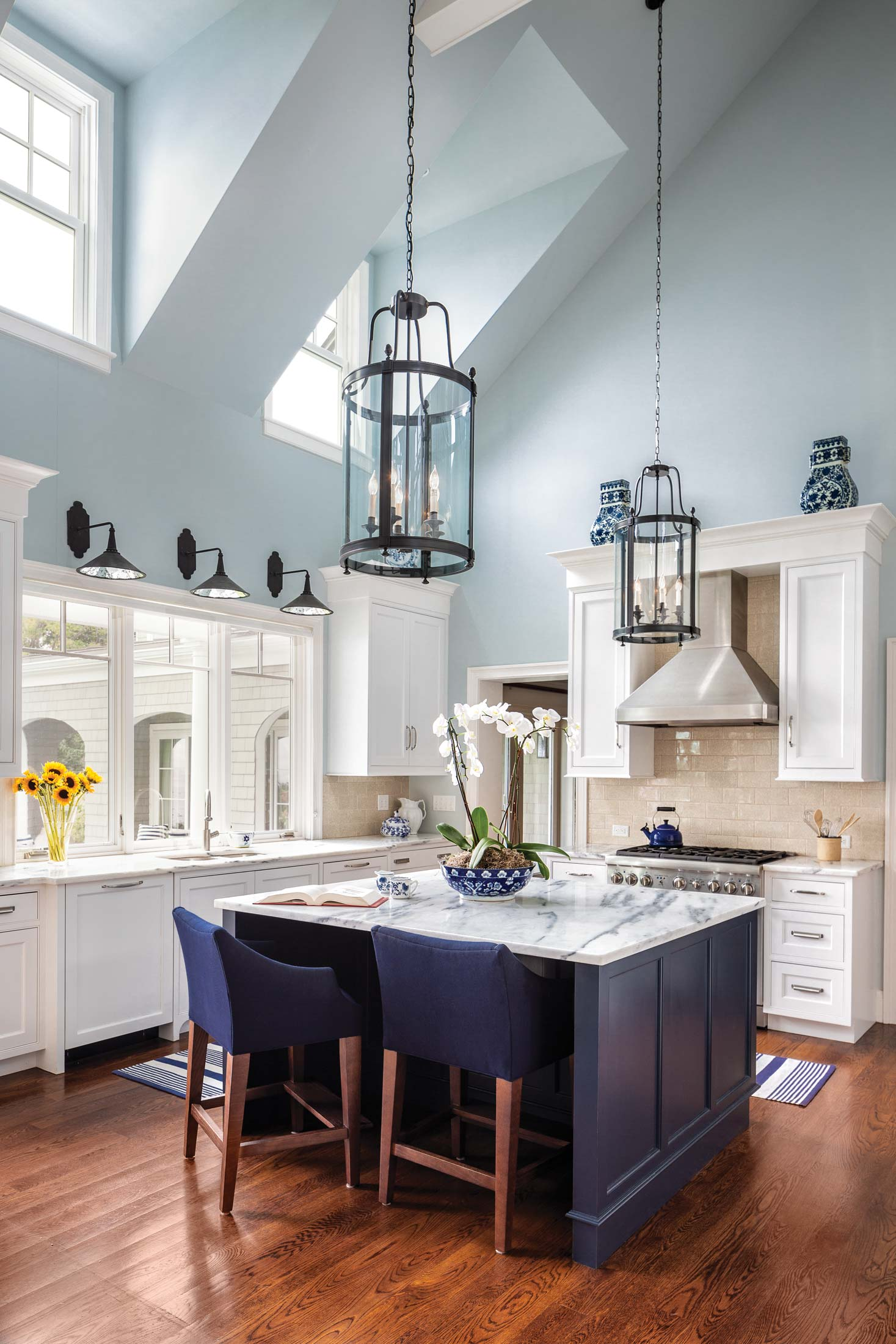 In the kitchen, marble countertops by Arens Stoneworks, pendant lamps from Simply Home, and cabinetry by Alex Hamilton of Tidewater Millwork make clean, classic statements.