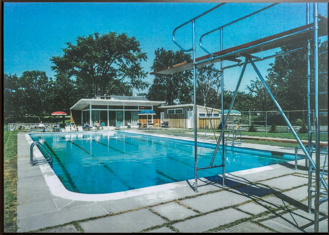 A vintage photograph provided by the Ethridges shows the pool and pool house original to the property.