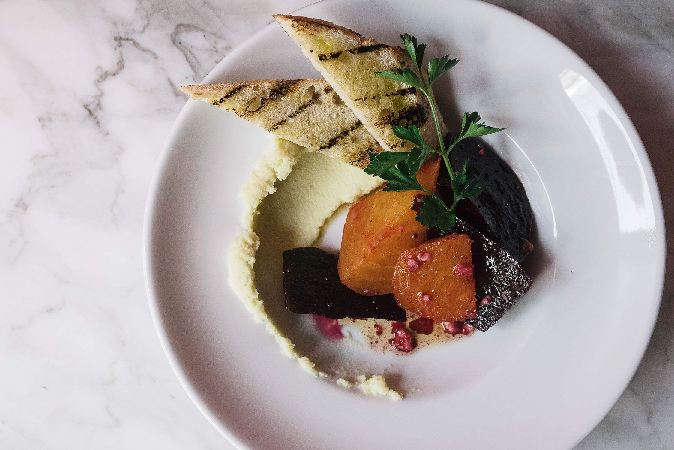 Roasted beets with Skorthalia, a rich and garlicky potato puree