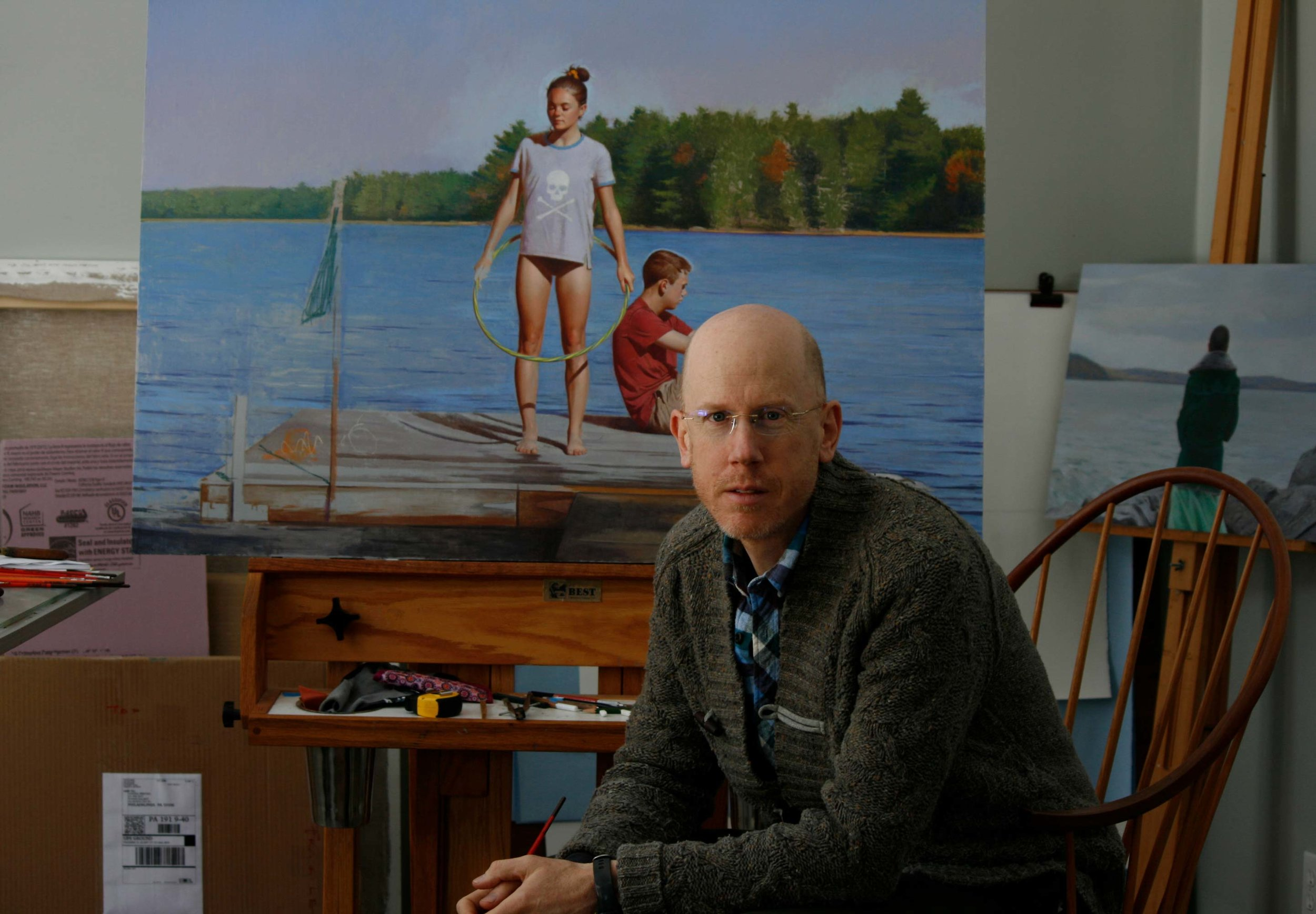 David Graeme Baker in his Hancock studio with a work in progress featuring his son Finn and Finn's friend Addi.