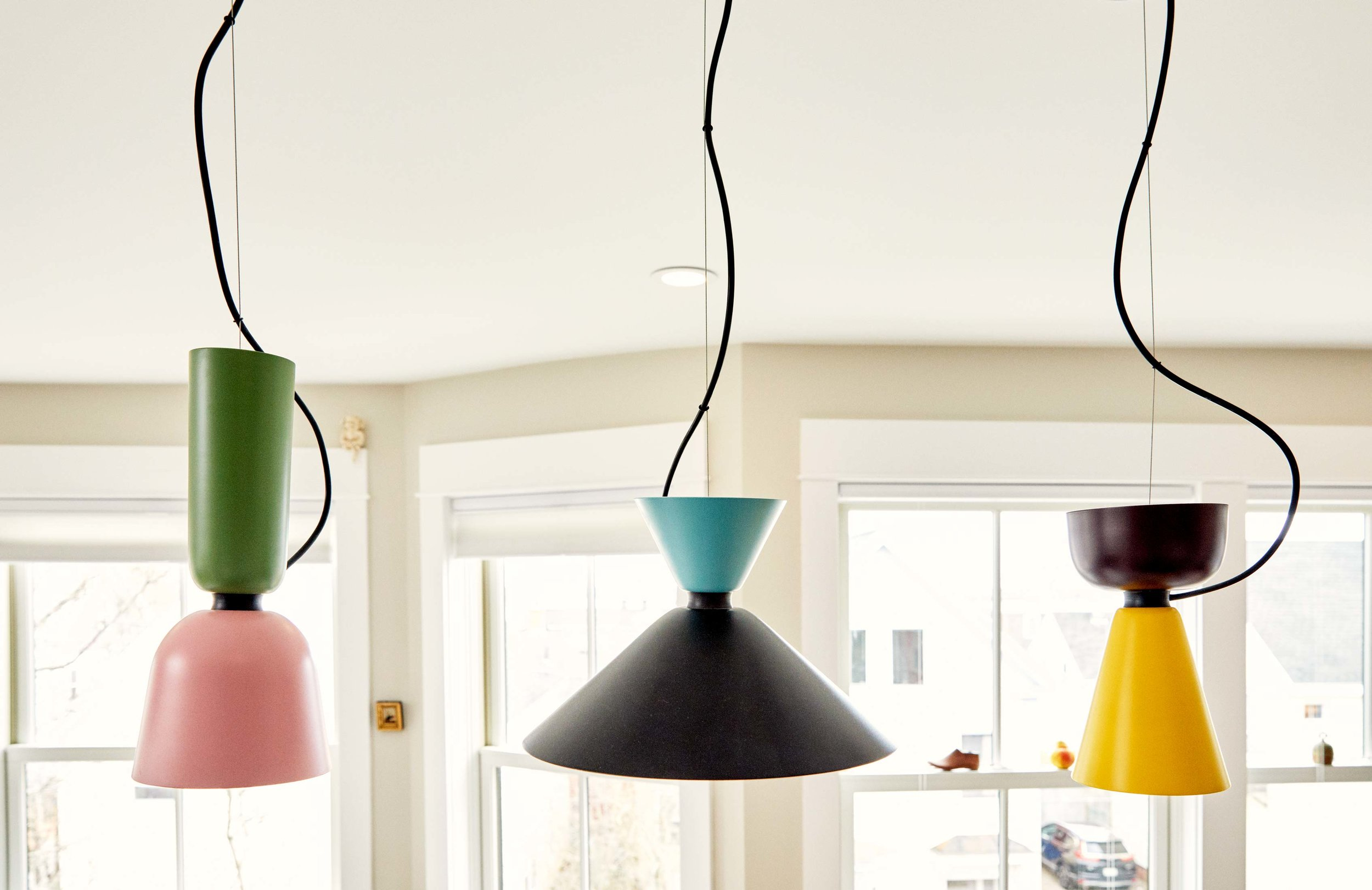 The colorful, whimsical light fixtures from Hem, a Danish company, were chosen by Soozie for their terrific character.