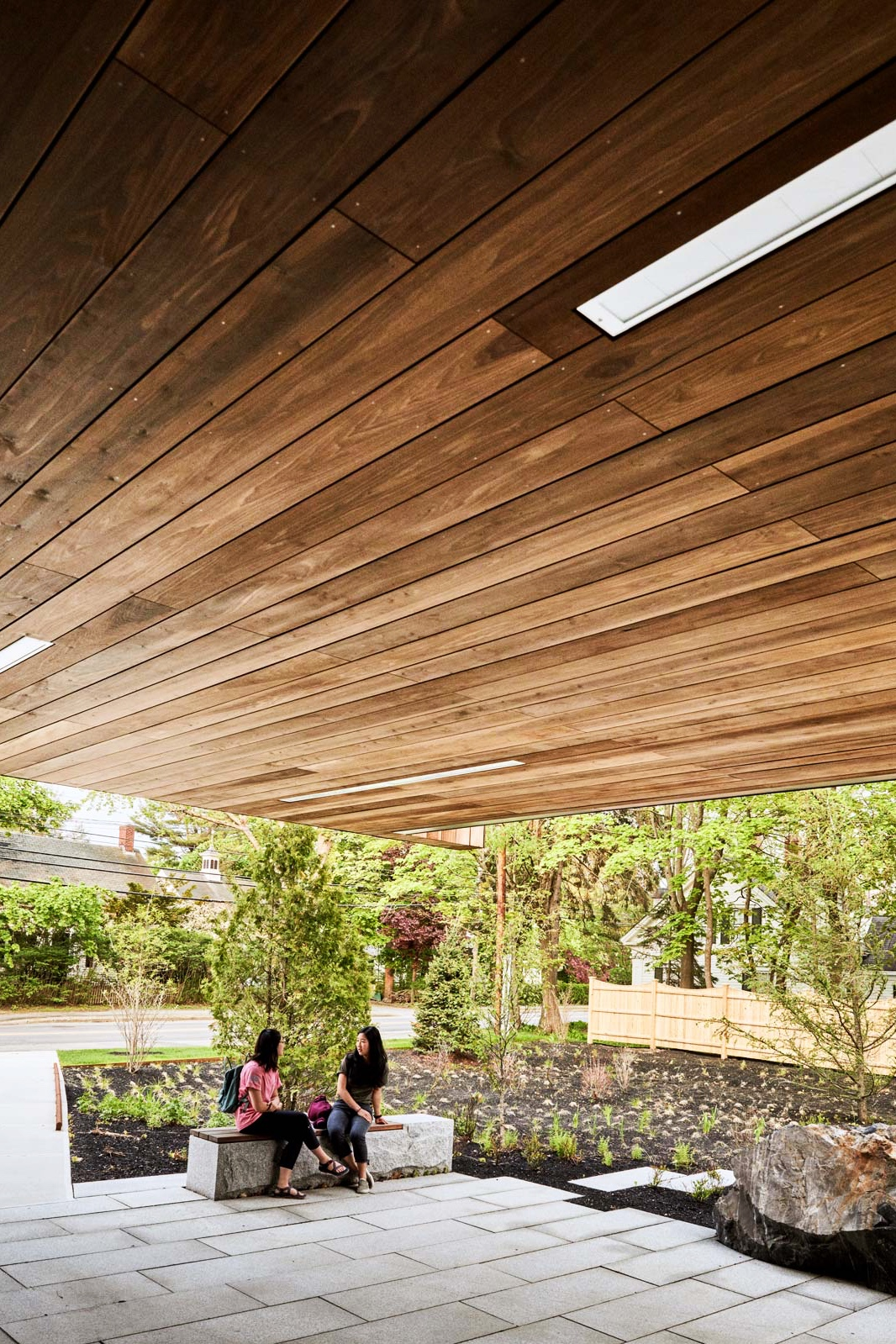 A terrace at the rear of the building offers a space to convene outdoors, while the flagstones and garden bed help to prevent stormwater runoff.