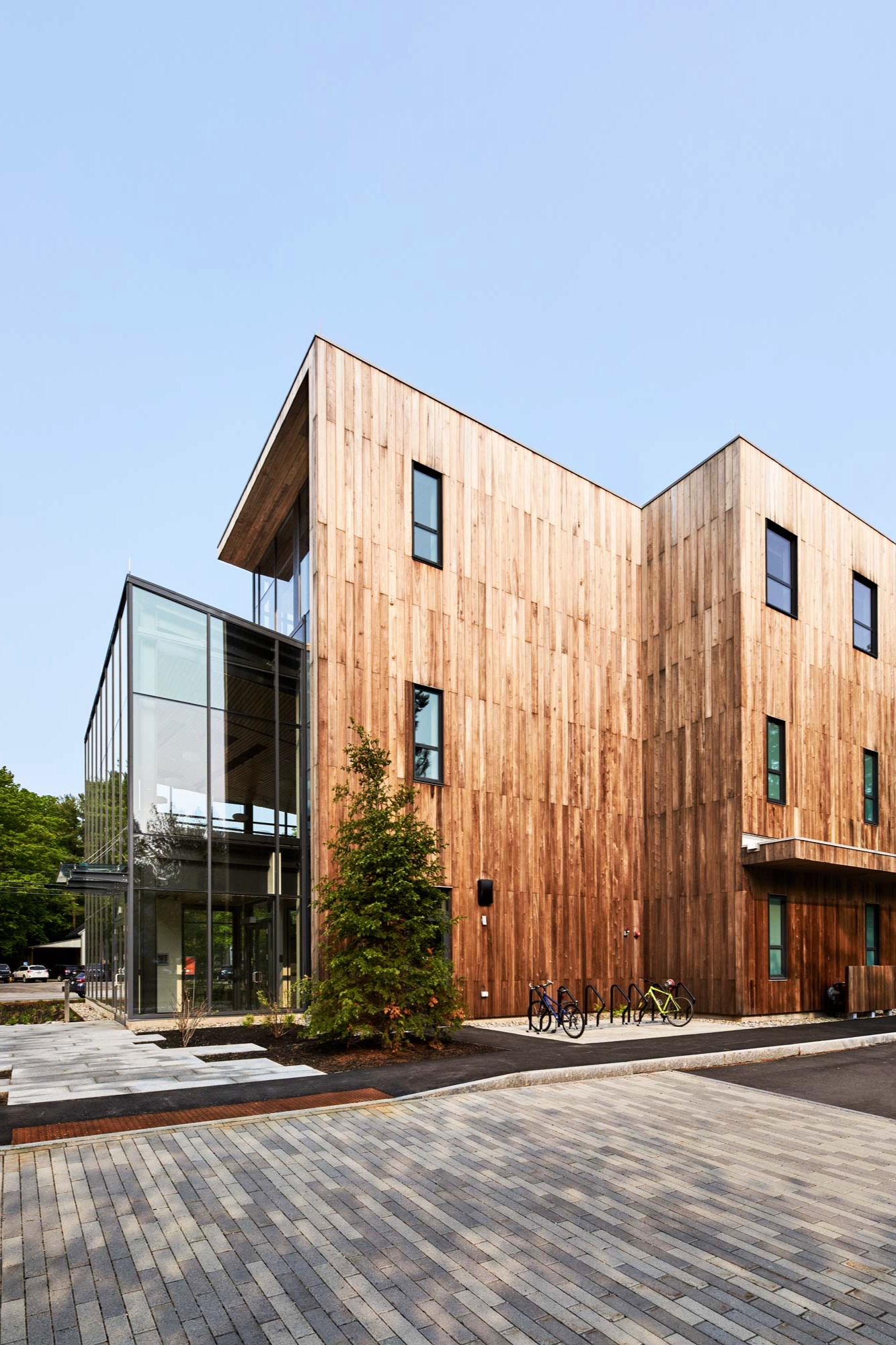 The exterior of the building is clad in a thermally treated poplar called Cambia that was sourced in Virginia and processed in New Hampshire. The wood will resist rot and will silver over time.